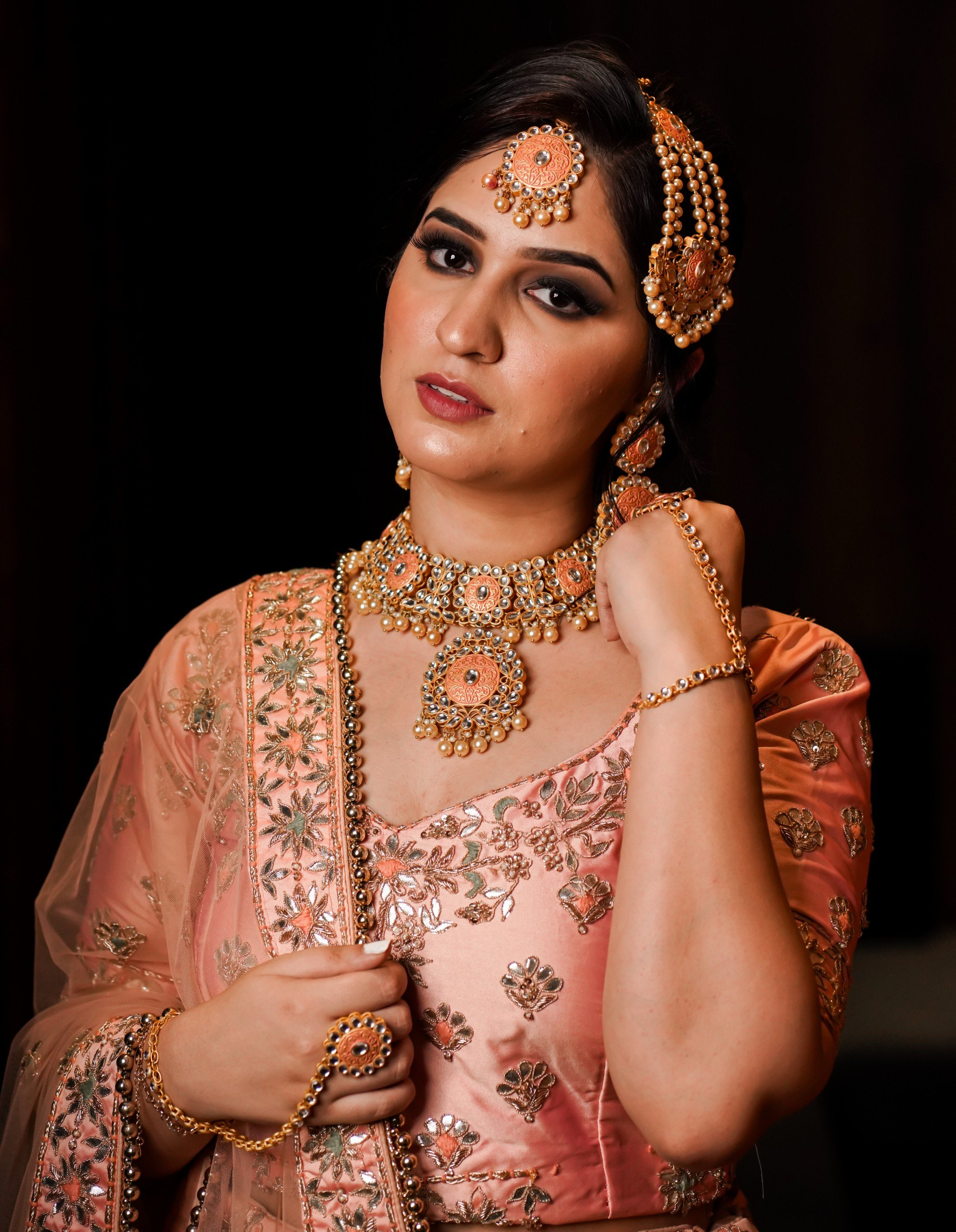 Pretty girl in traditional Indian bridal costume