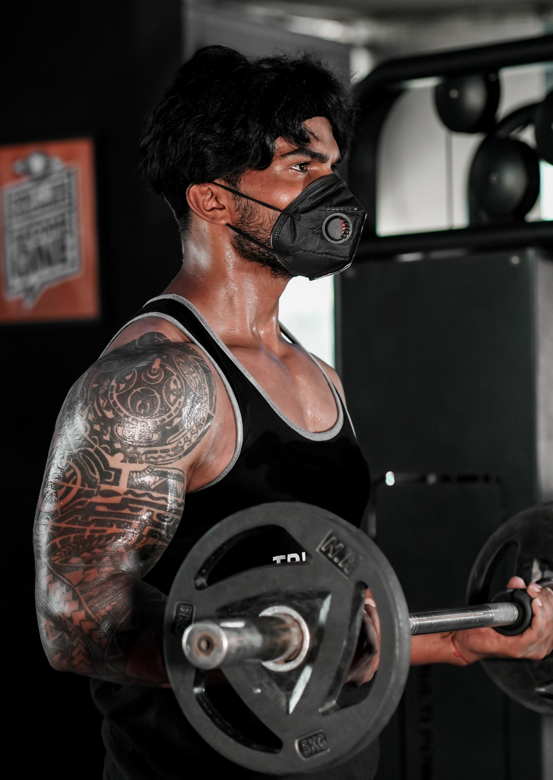 bicep curls with barbell at gym
