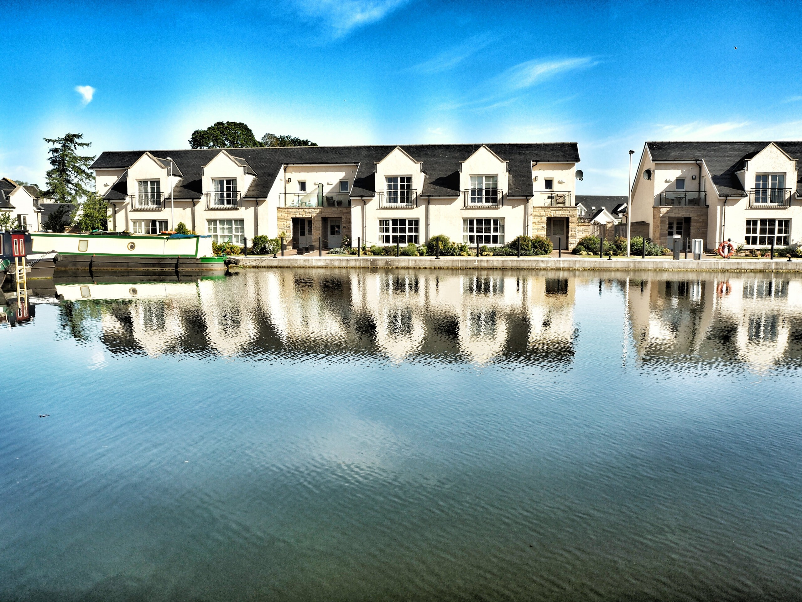 Row of houses in front of a lake