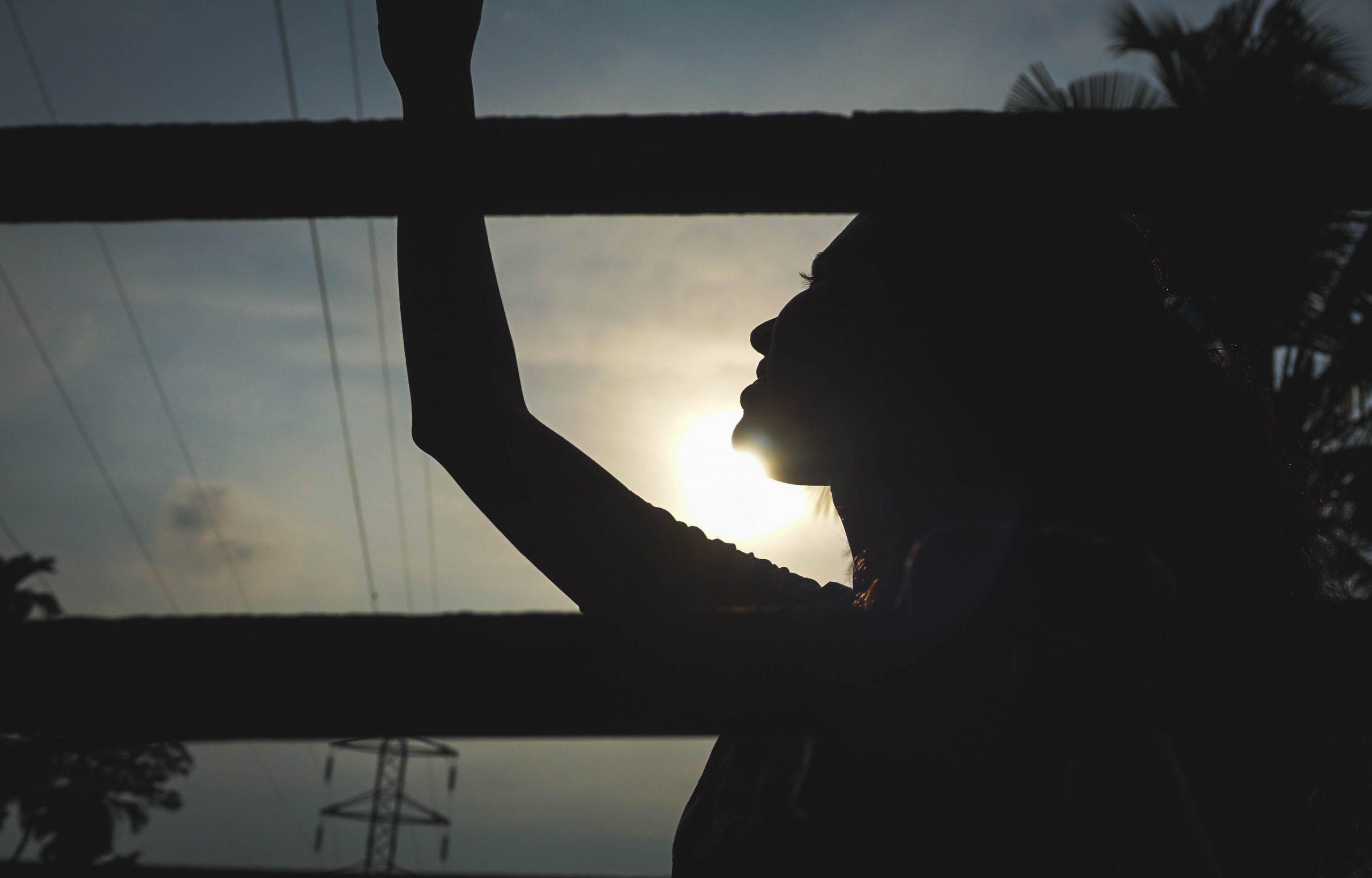 silhouette of a girl against the sun