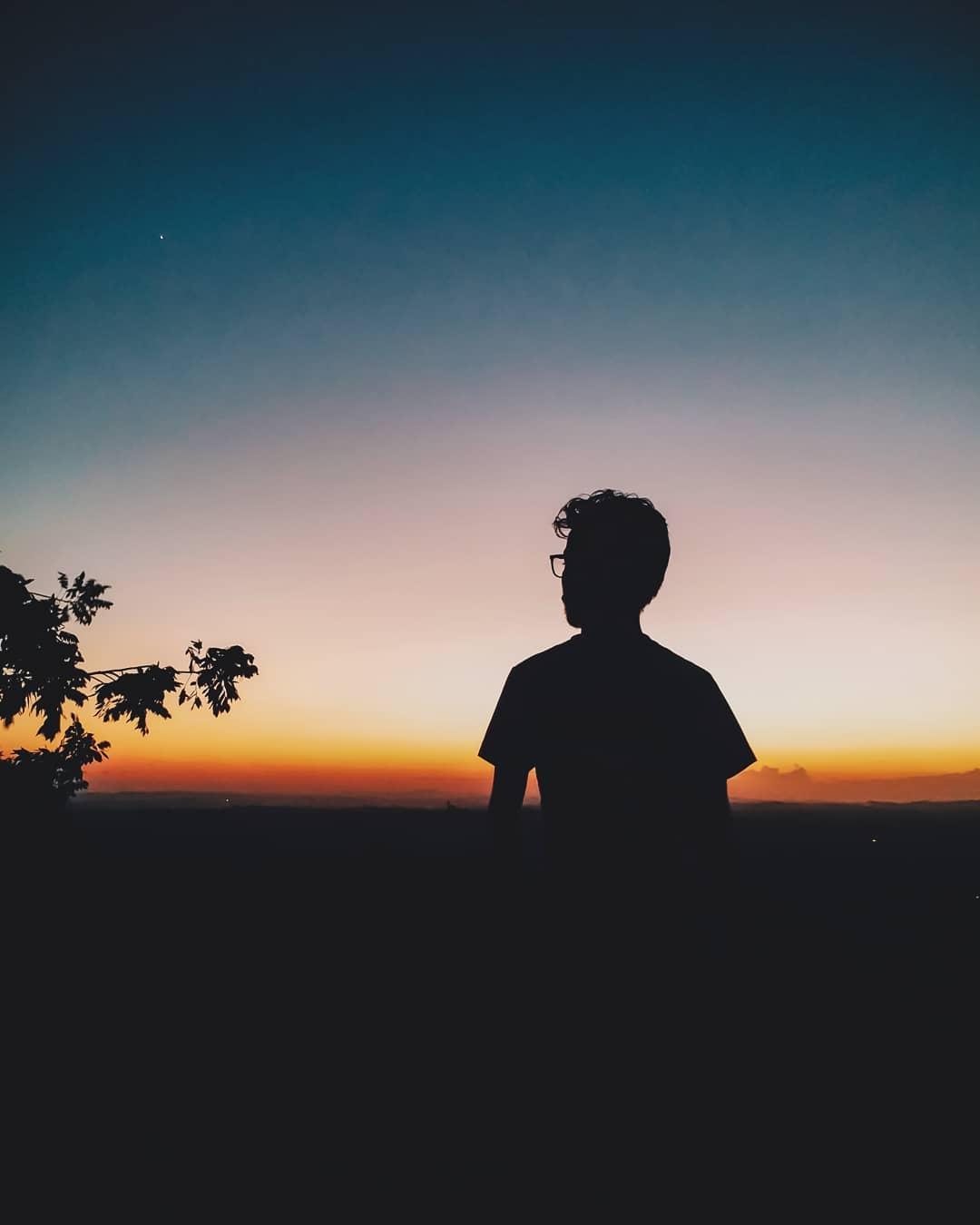 A boy in dark light