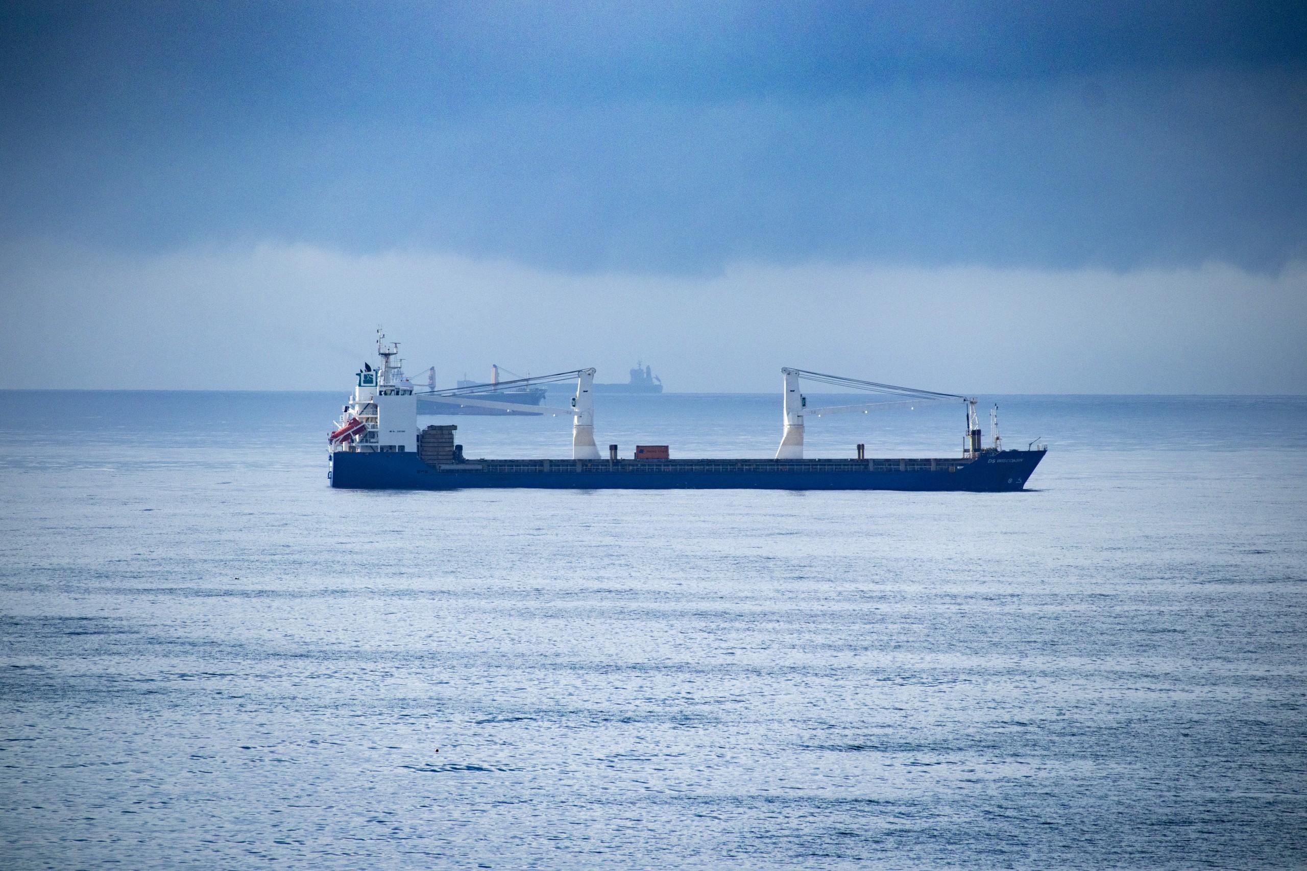 Ship and overcast sea