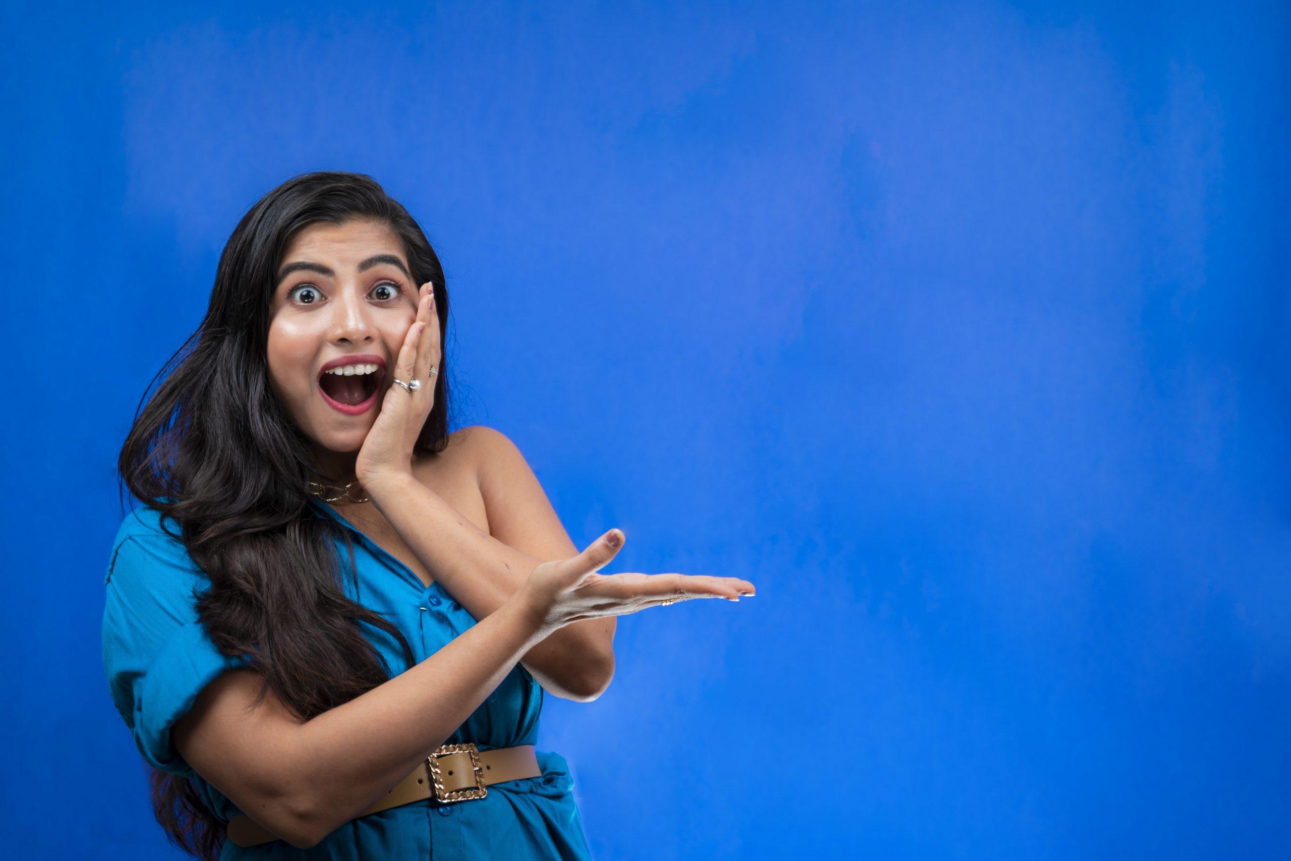 Shocked Indian Girl on Blue Background