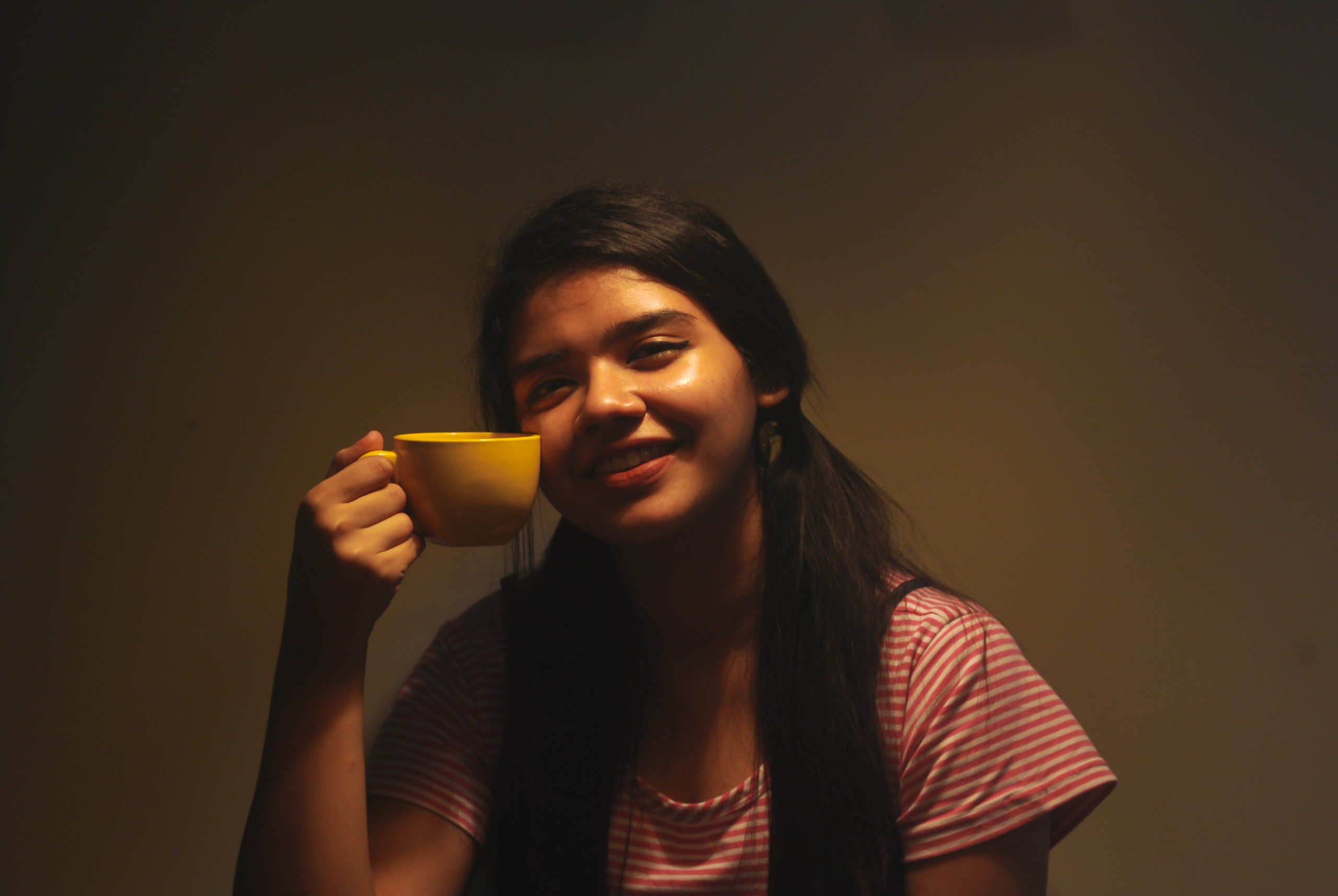 Woman happily holding a cup