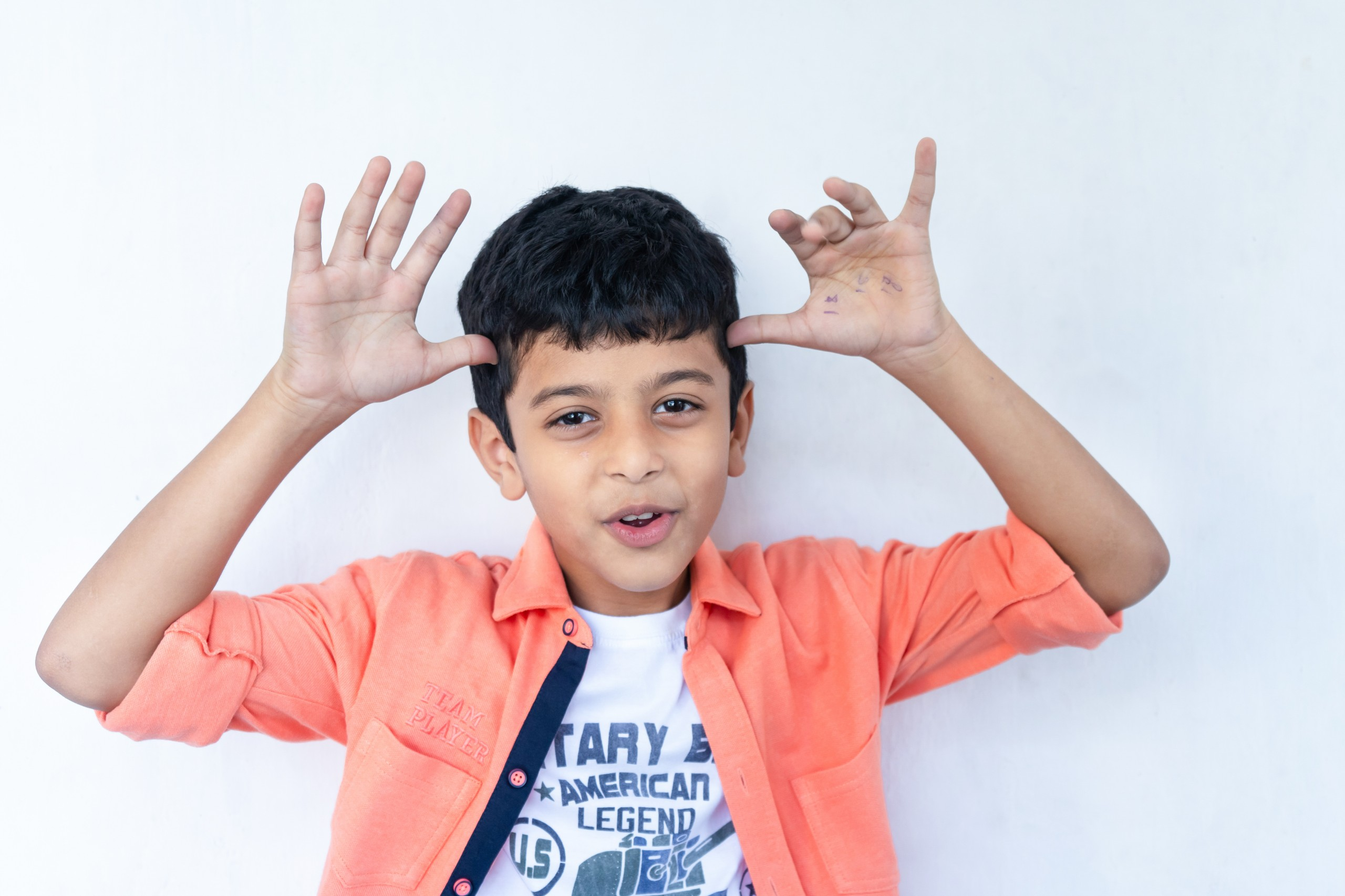 Smiling boy making a gesture