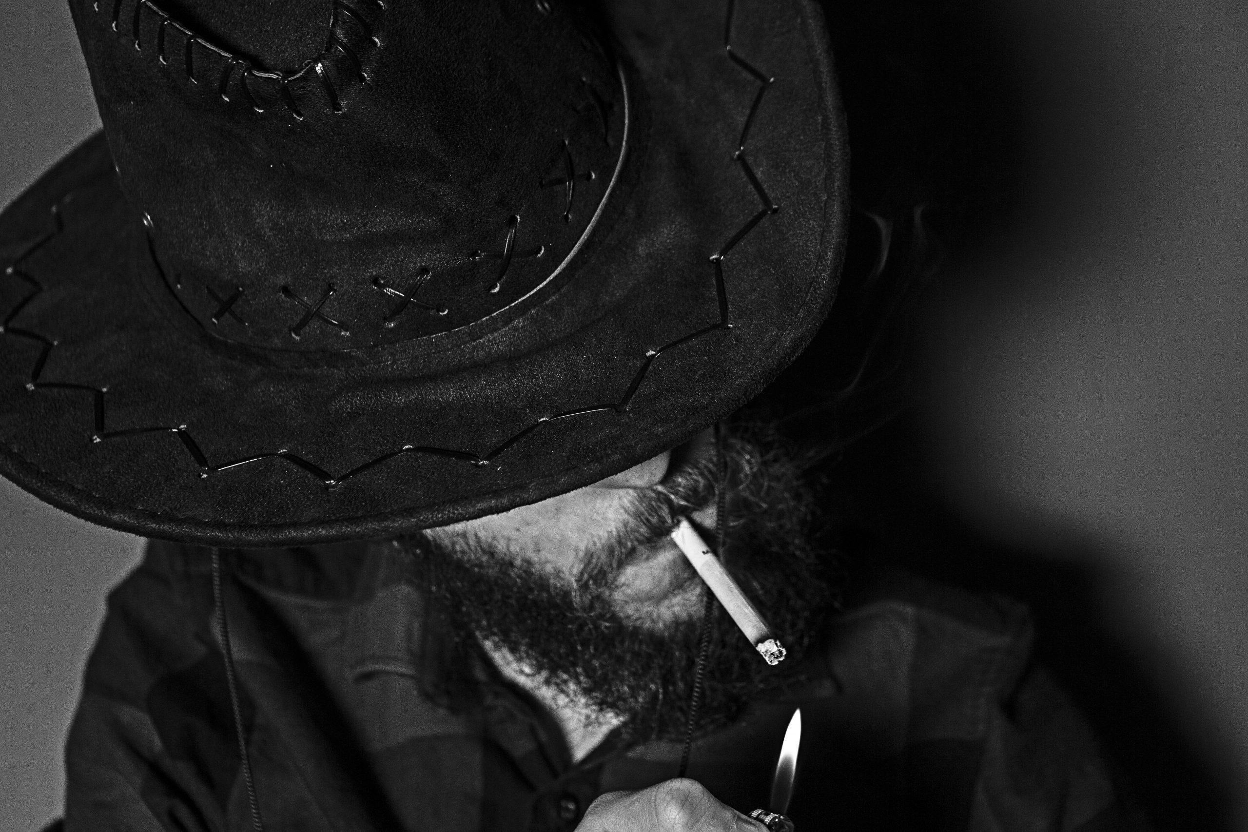 Smoking man with cowboy hat
