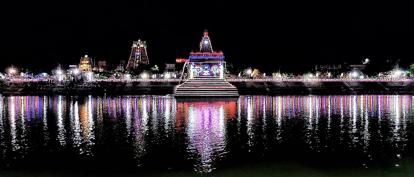 Temple Reflection in Water at Night