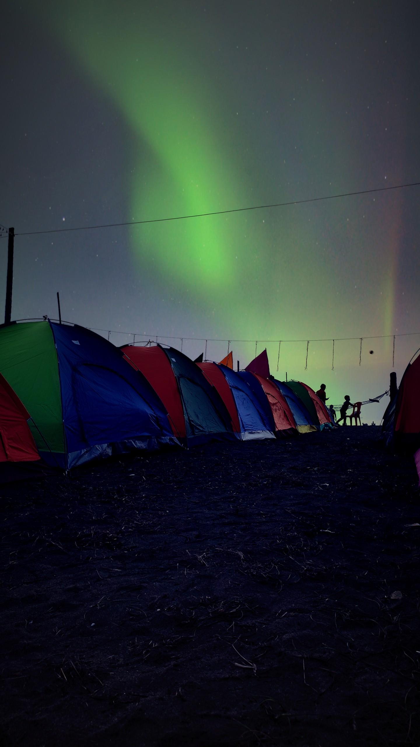 Tents under Aurora Borealis