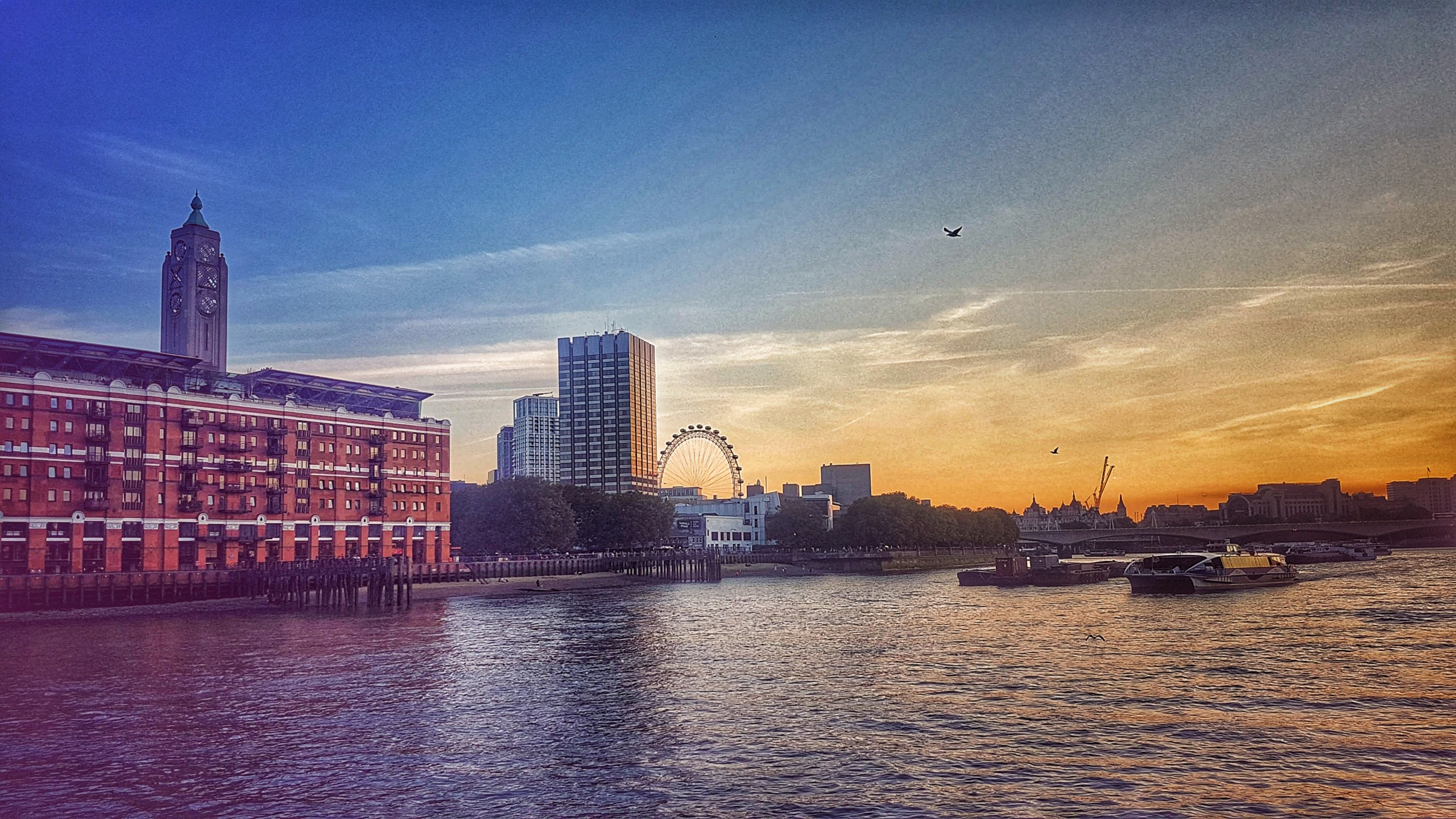 The london eye overlooking thames river