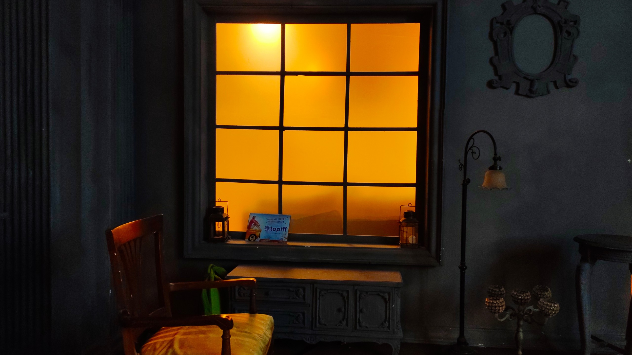 A chair by the window