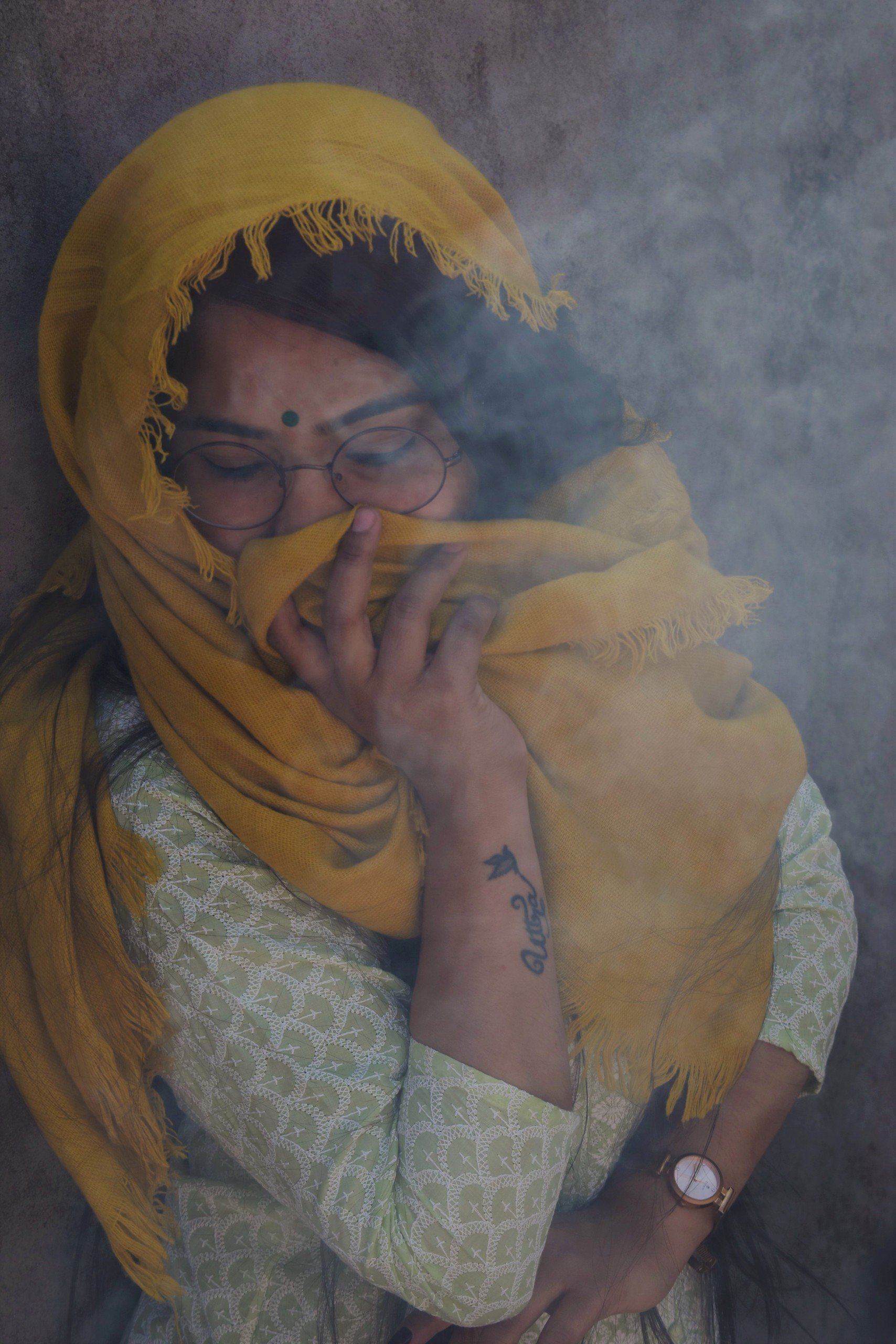 Woman covering nose from smoke