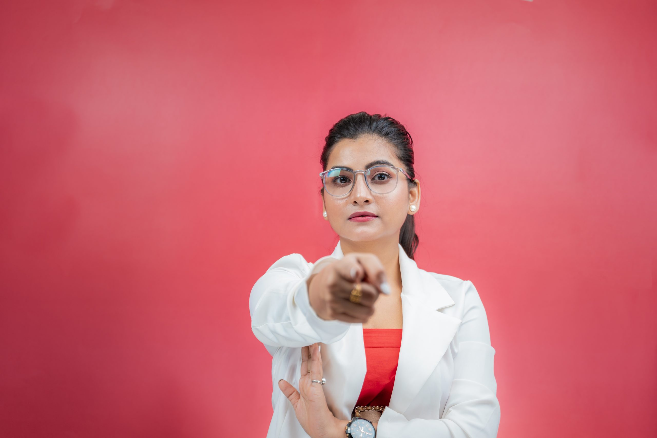 Woman pointing finger towards the camera