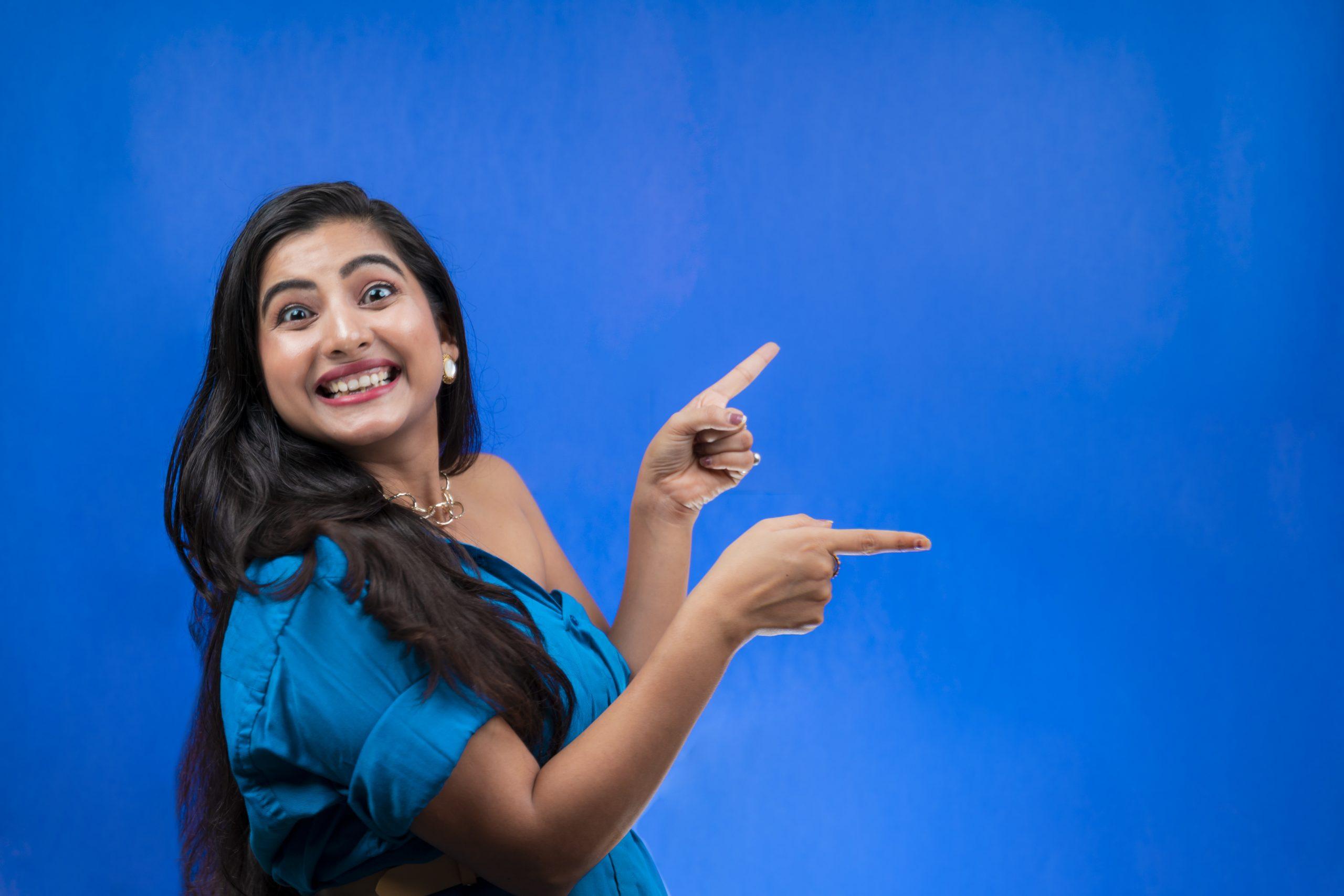 Woman pointing sideways