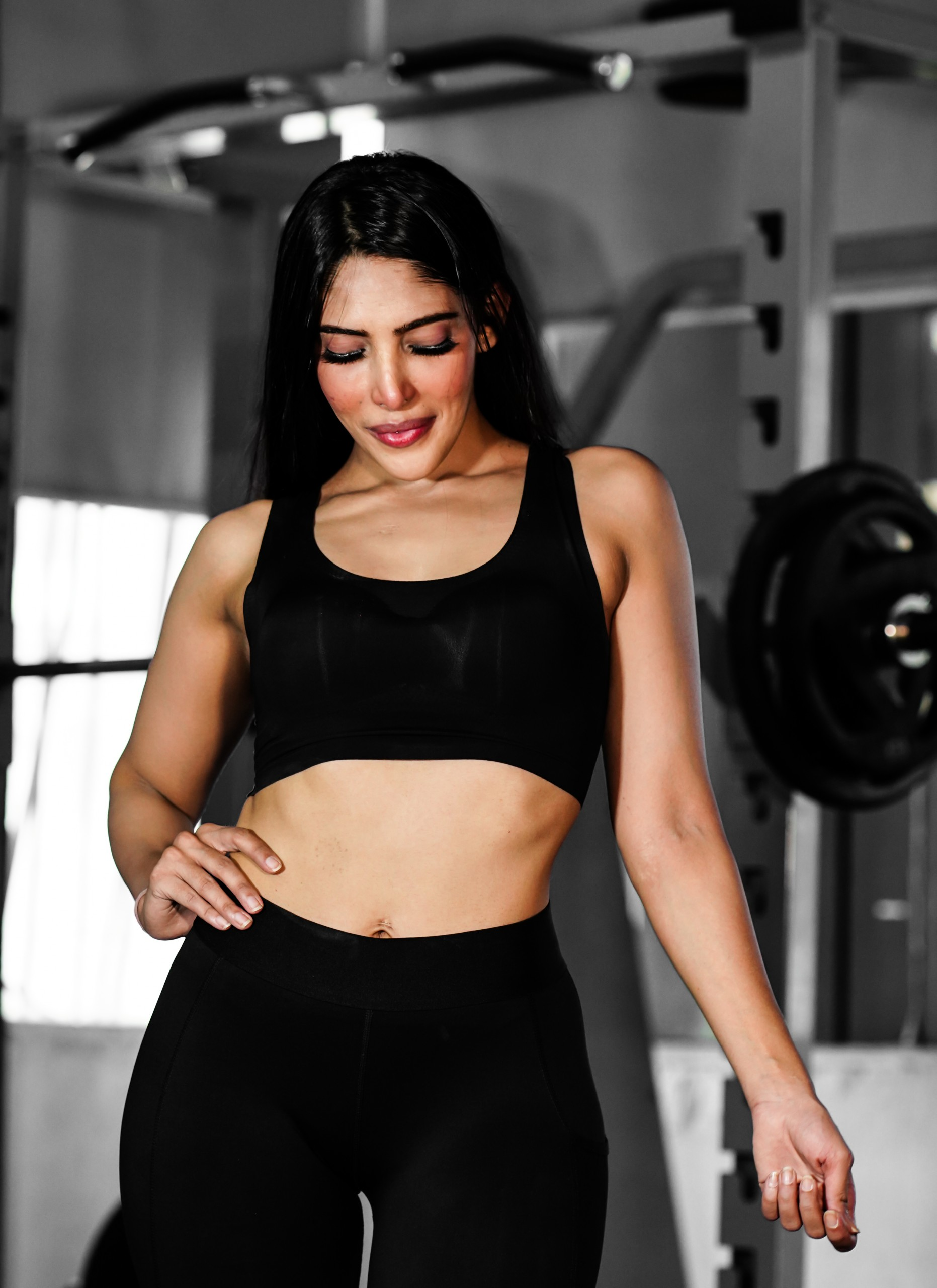 Young girl in black poses in gym