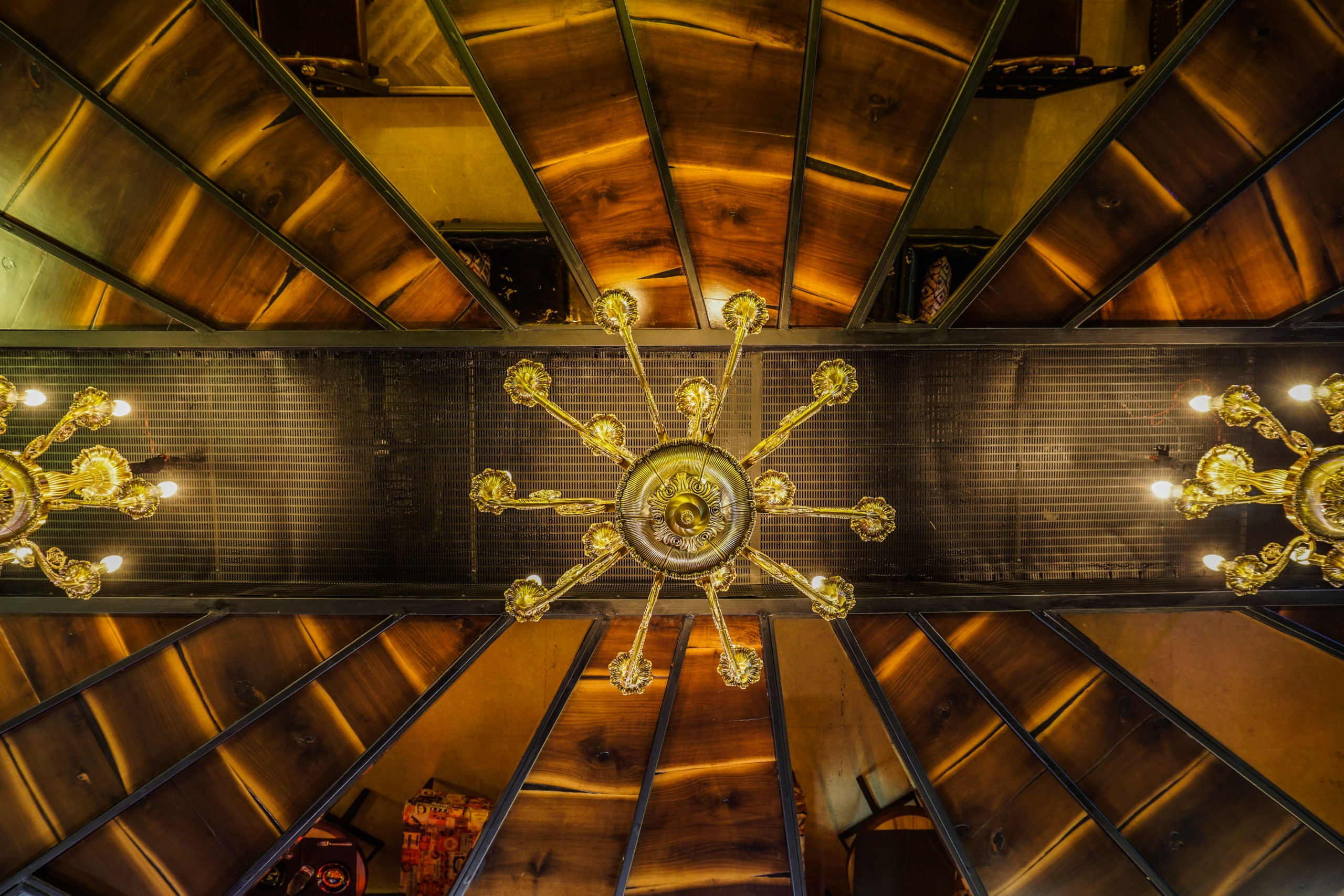 a kaleidoscopic roof with mirrors and chandelier