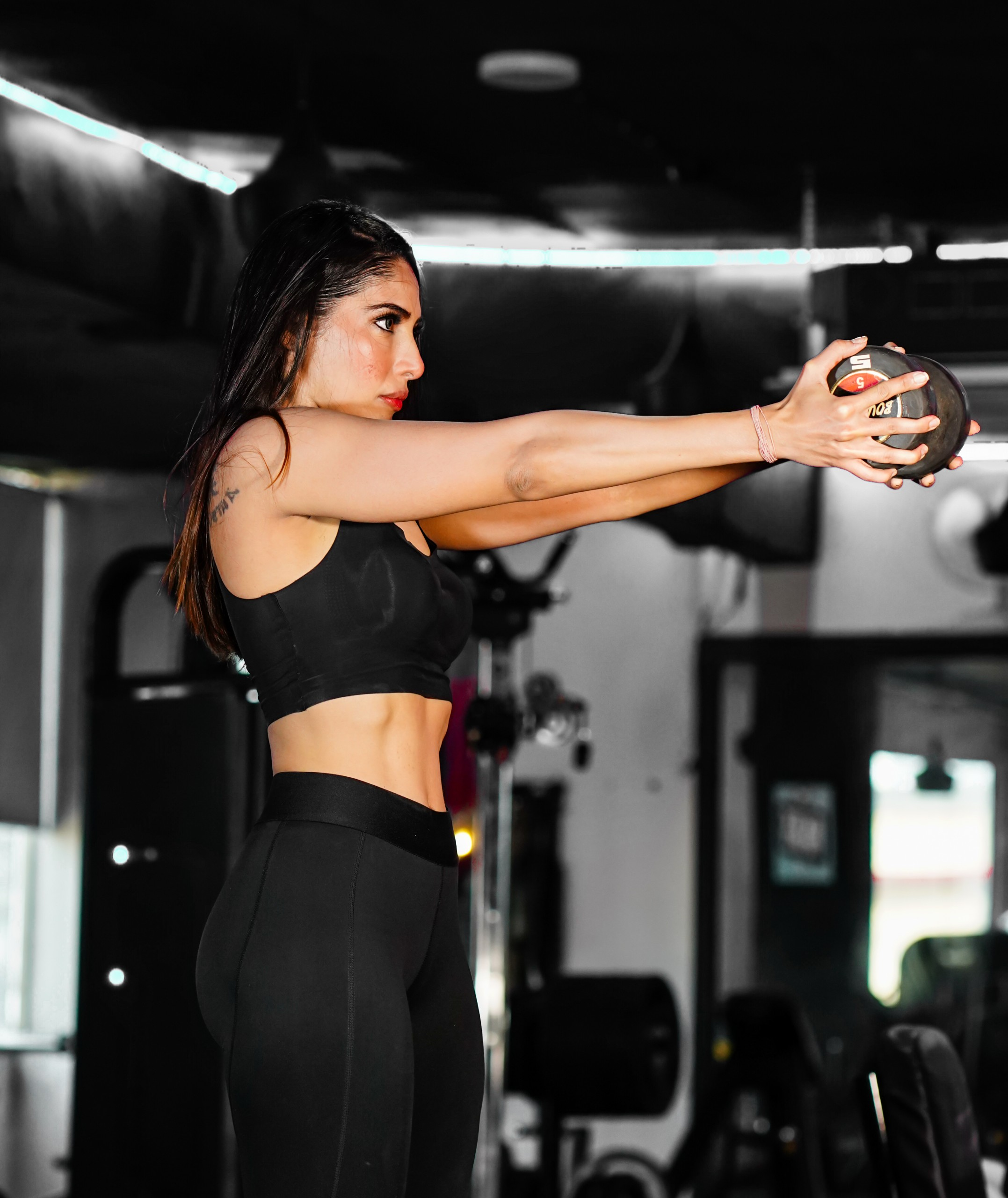 lady working out with dumbbell