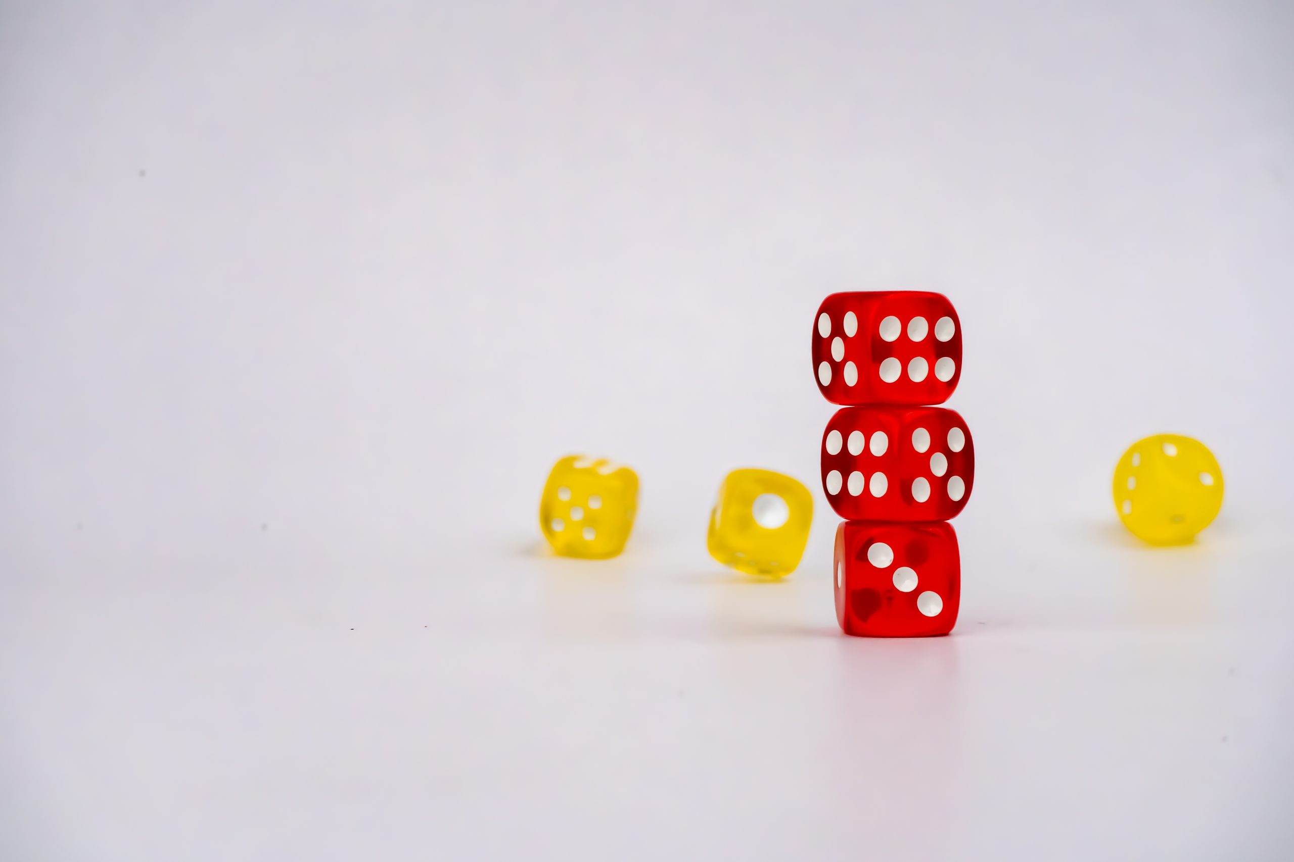 3 Red dices with yellow dices in background