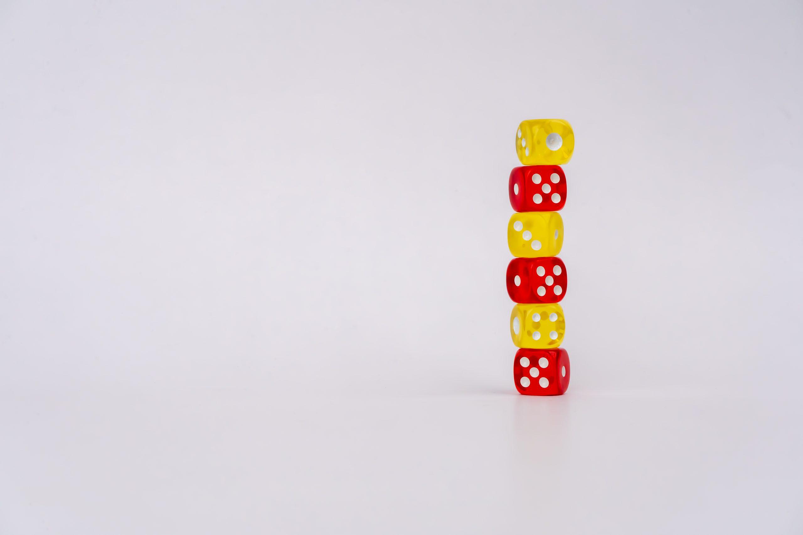 red an yellow dice balancing