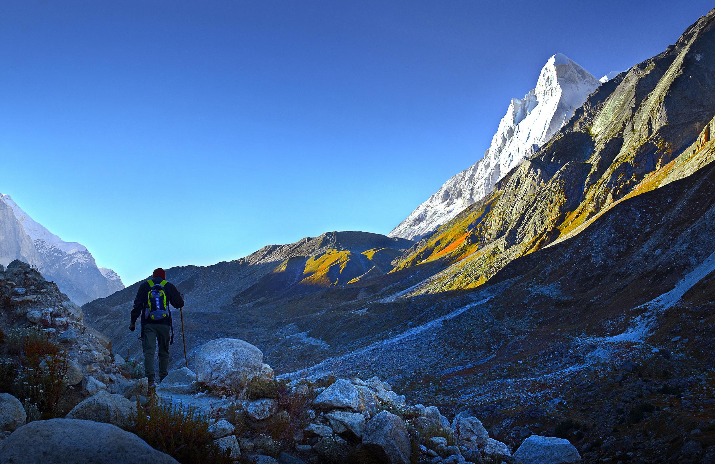A Man Walking Towards the Mountain