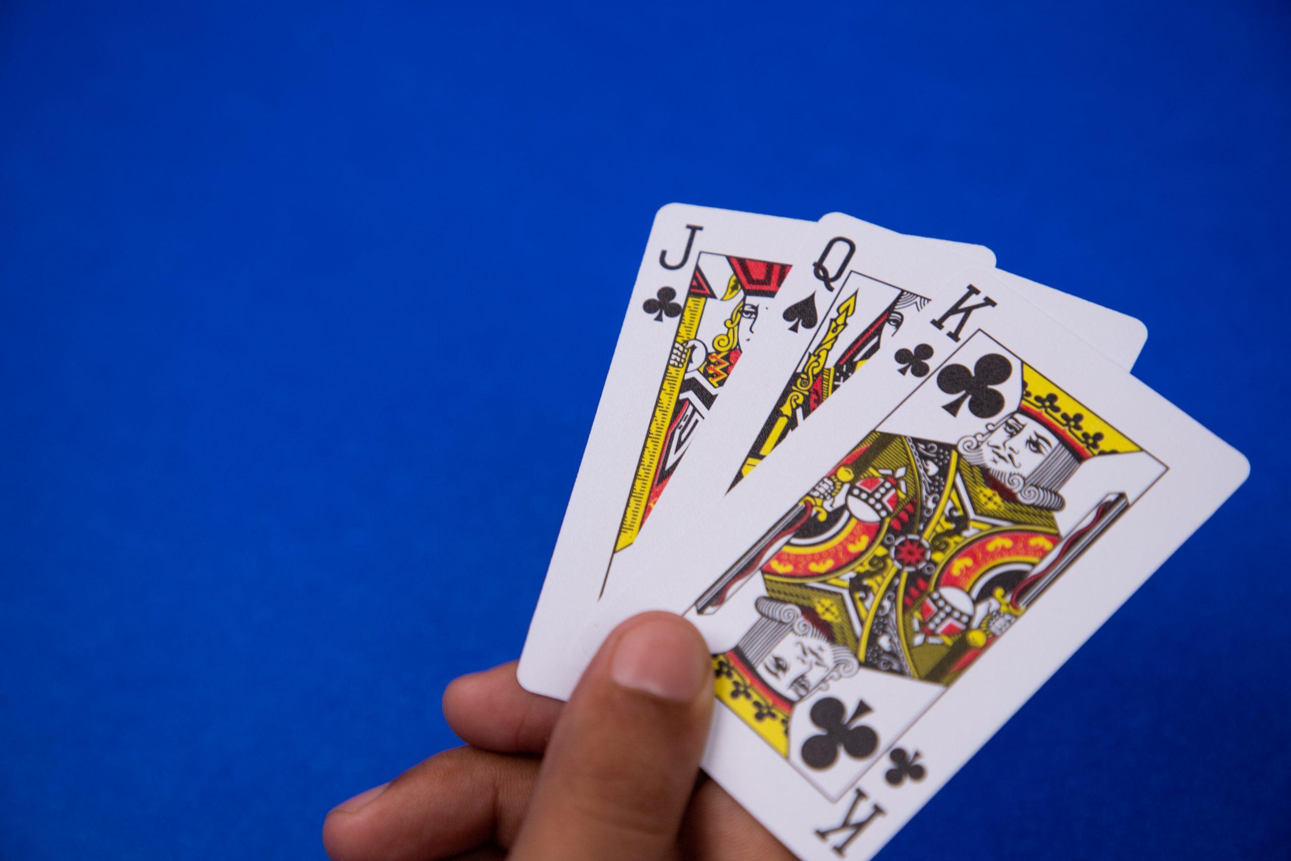 A Teenpatti card in Hand