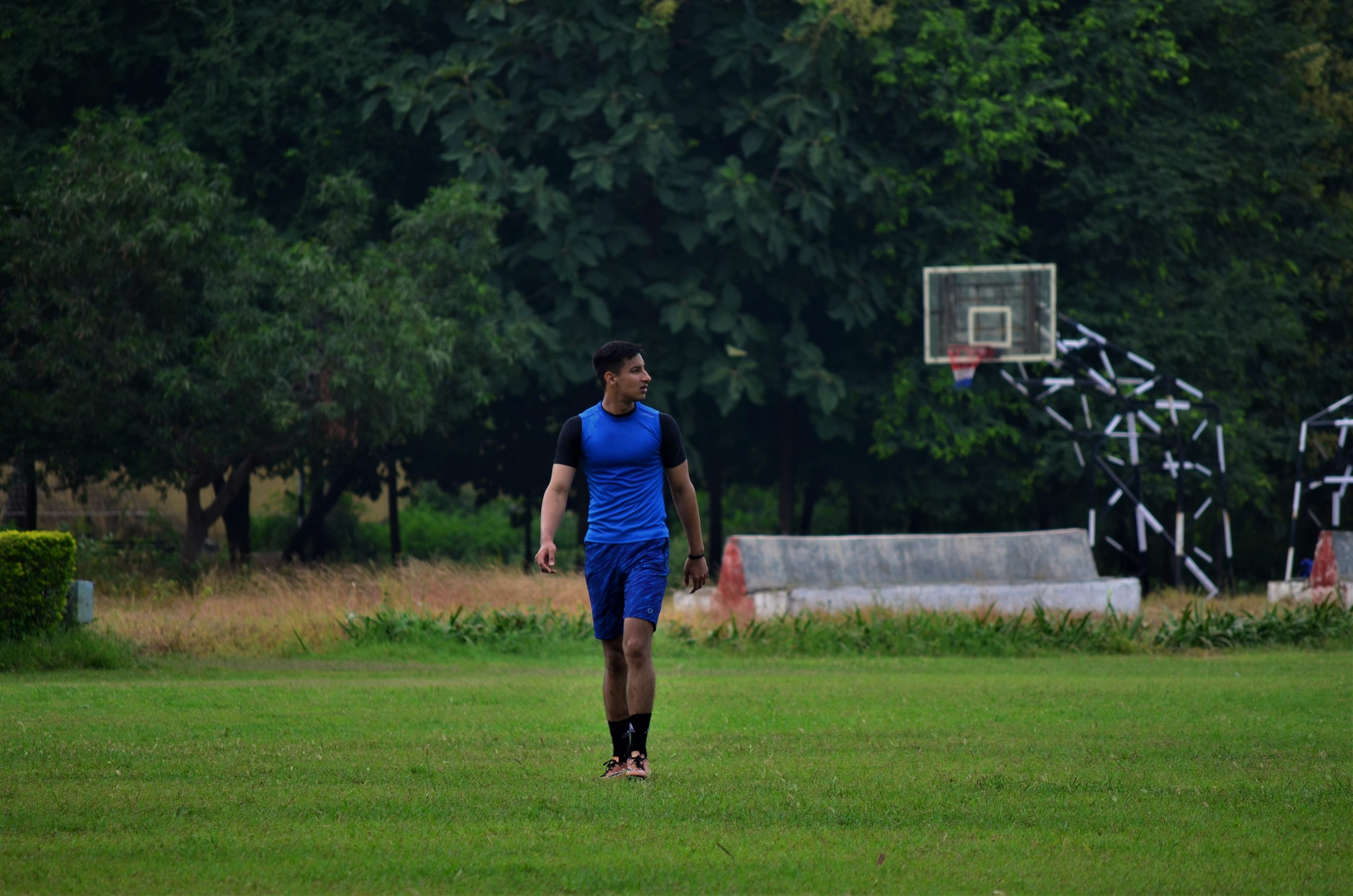 A basketball player walking across the field