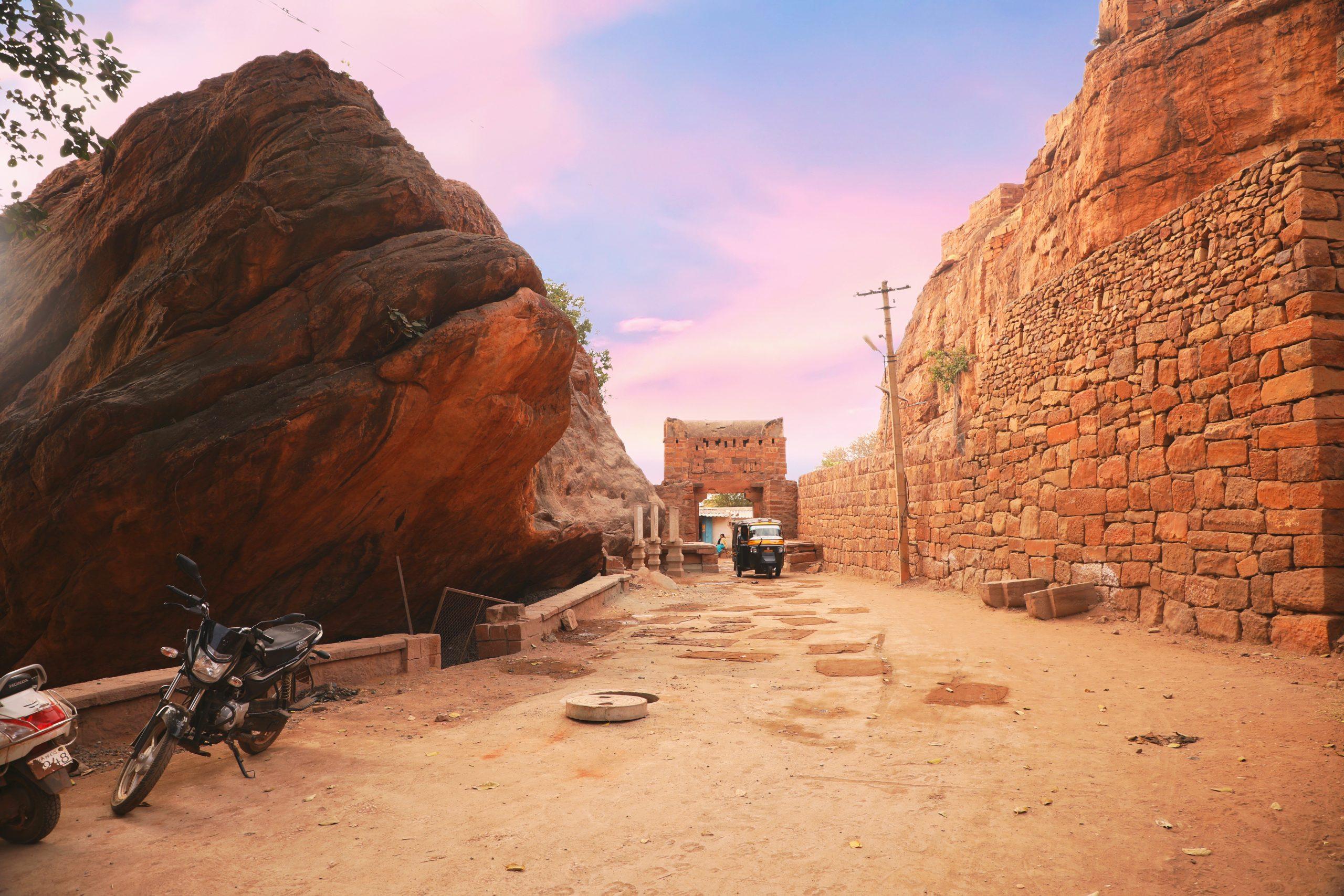 A big rock beside a dirt road in Karnataka