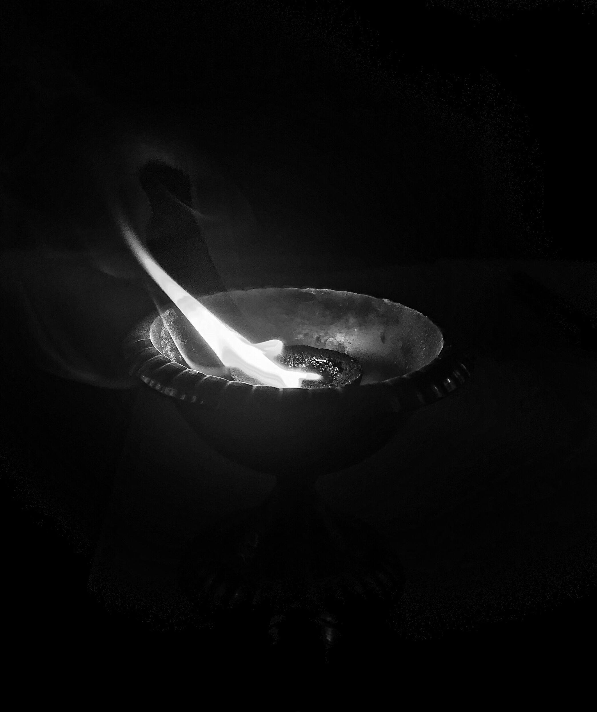 A black and white shot of a diya