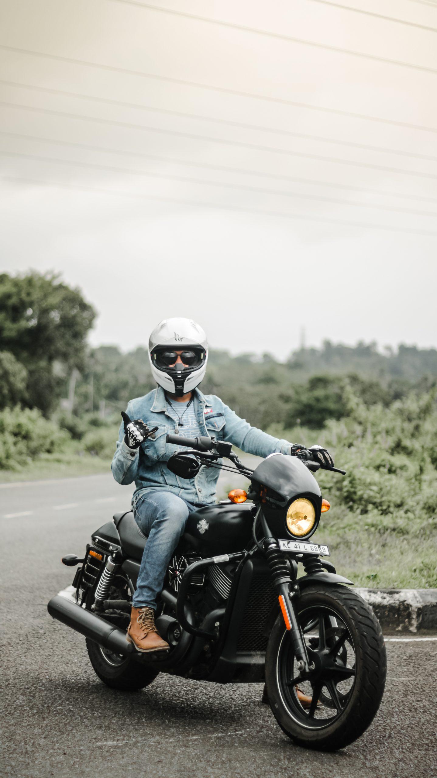 A boy on heavy engine bike
