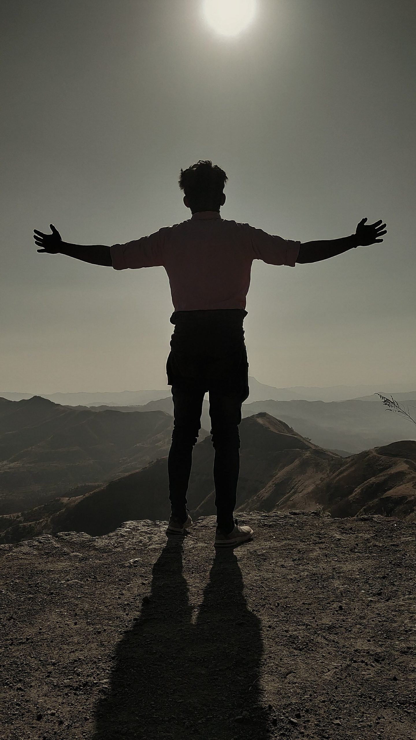 A boy standing on a cliff