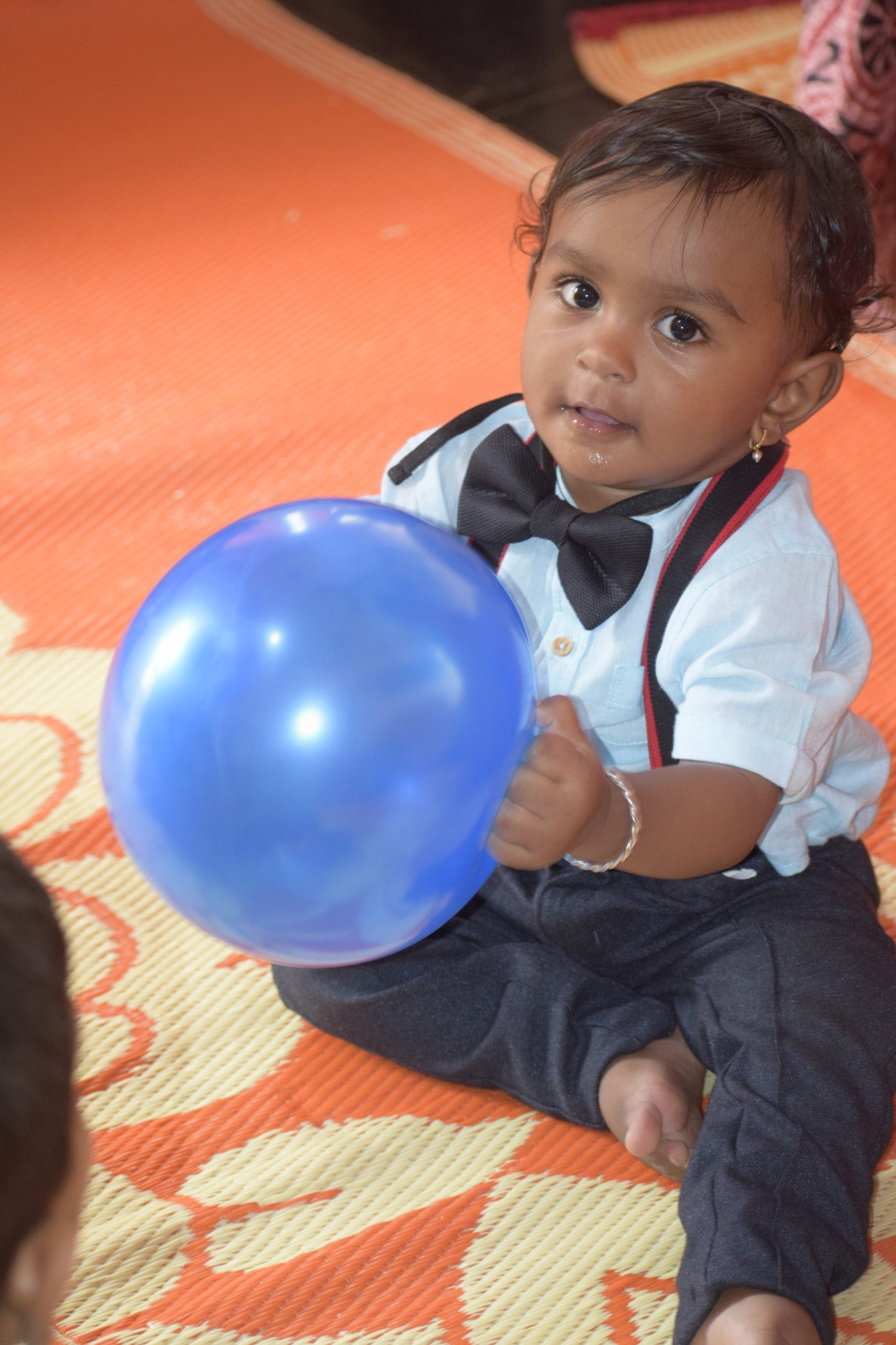 A child holding a balloon