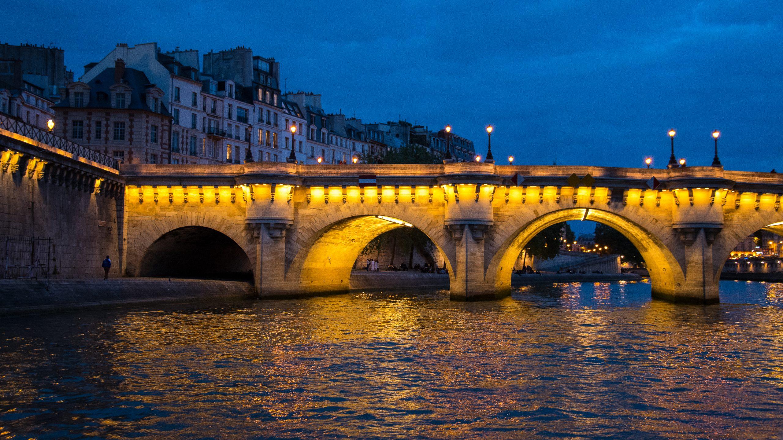 Night view of bridge in Paris.