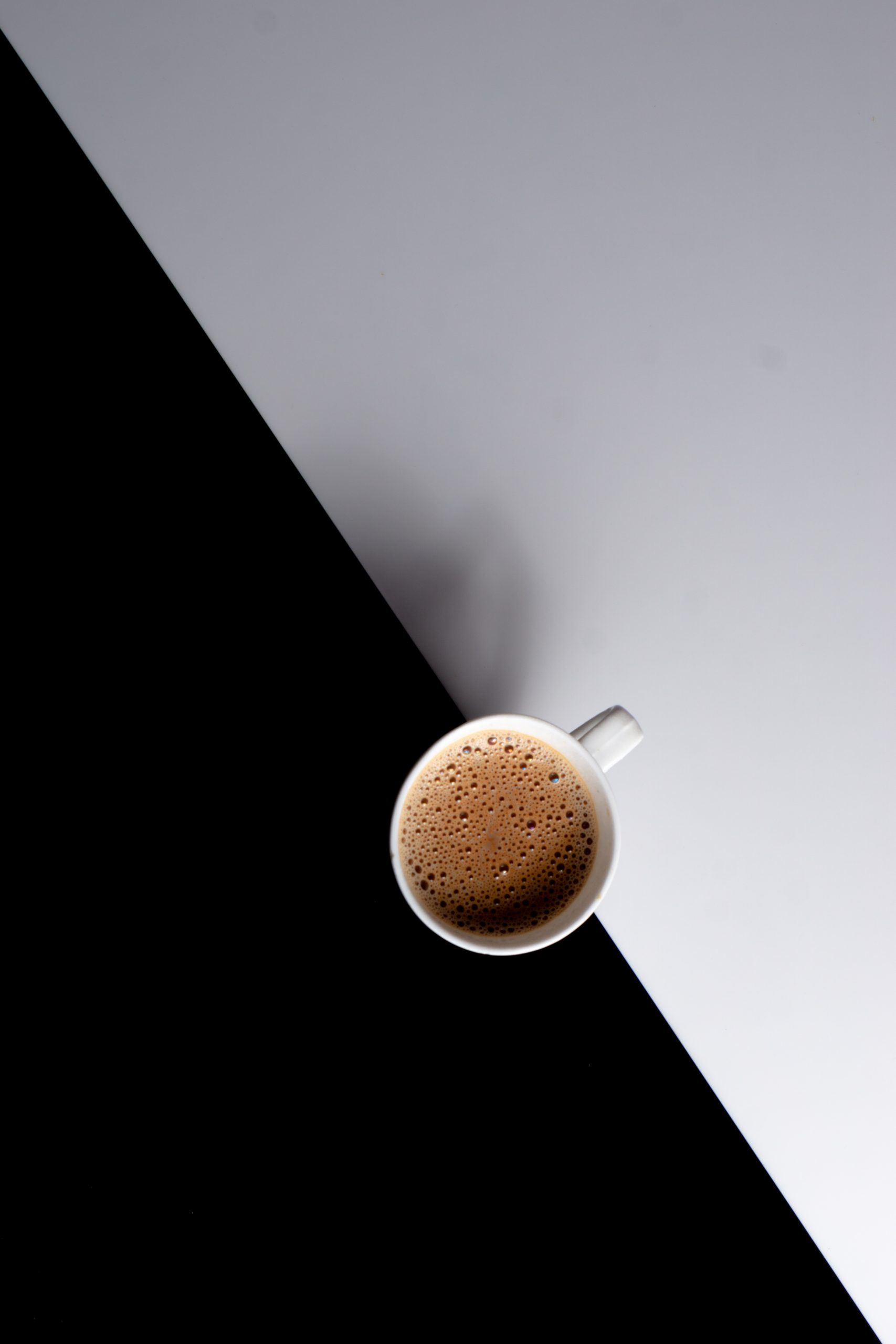 A cup of tea on a black and white background.