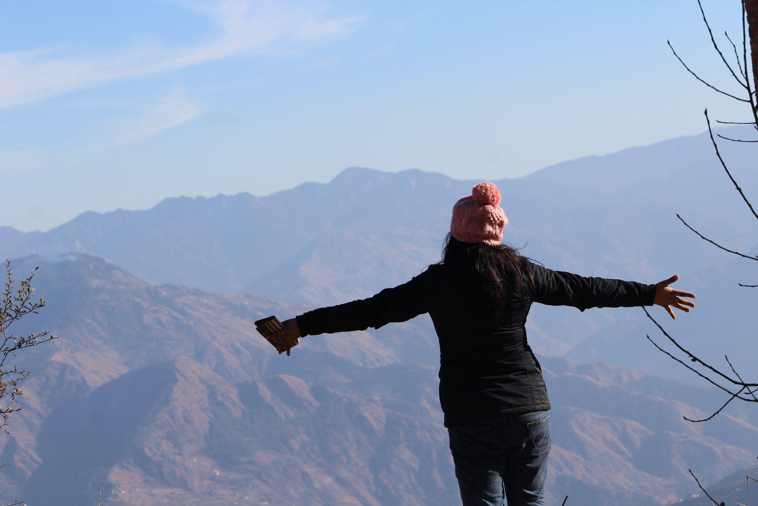 girl enjoying mountain view