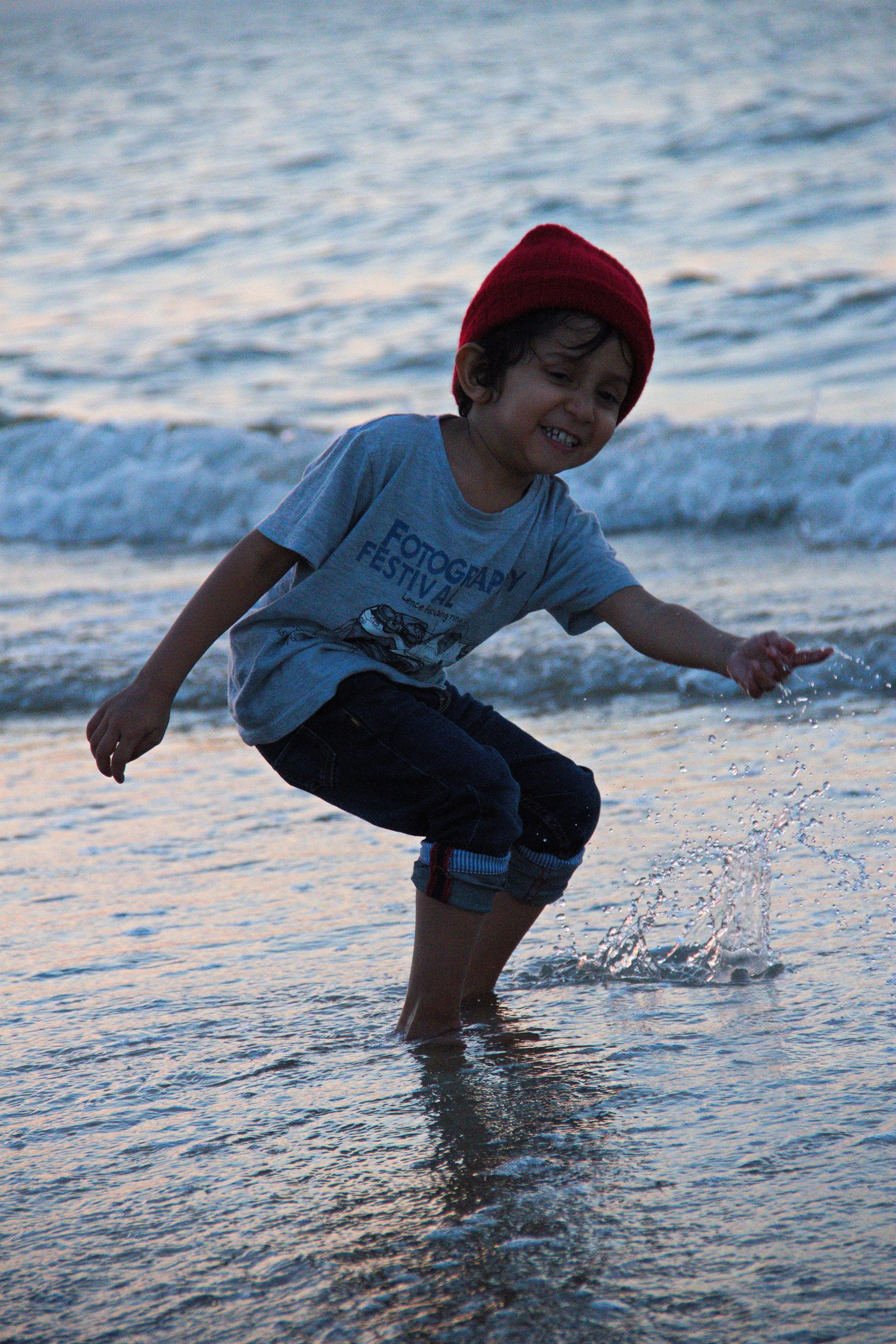 A Boy Playing on the Beach