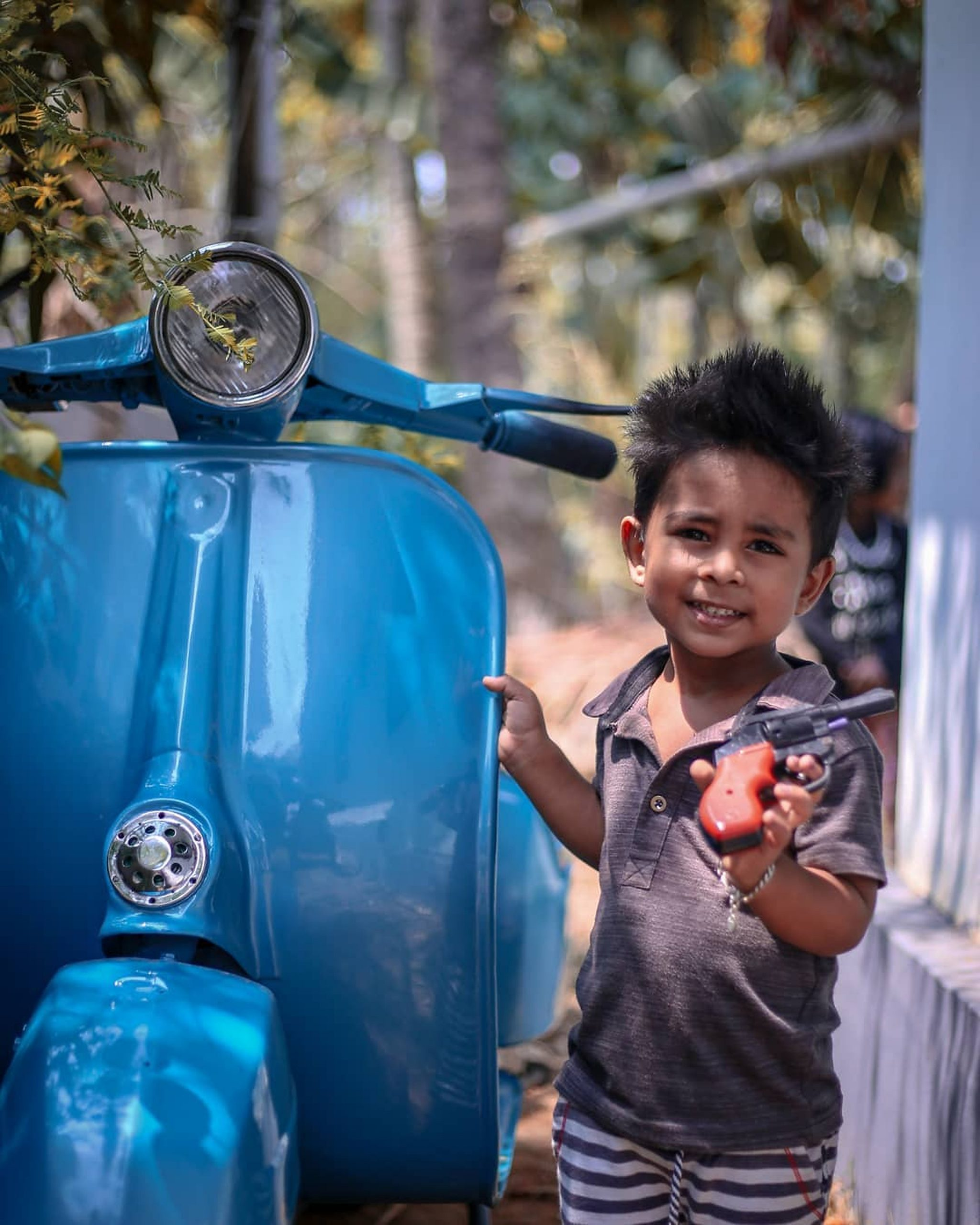 A kid with Blue Scooter