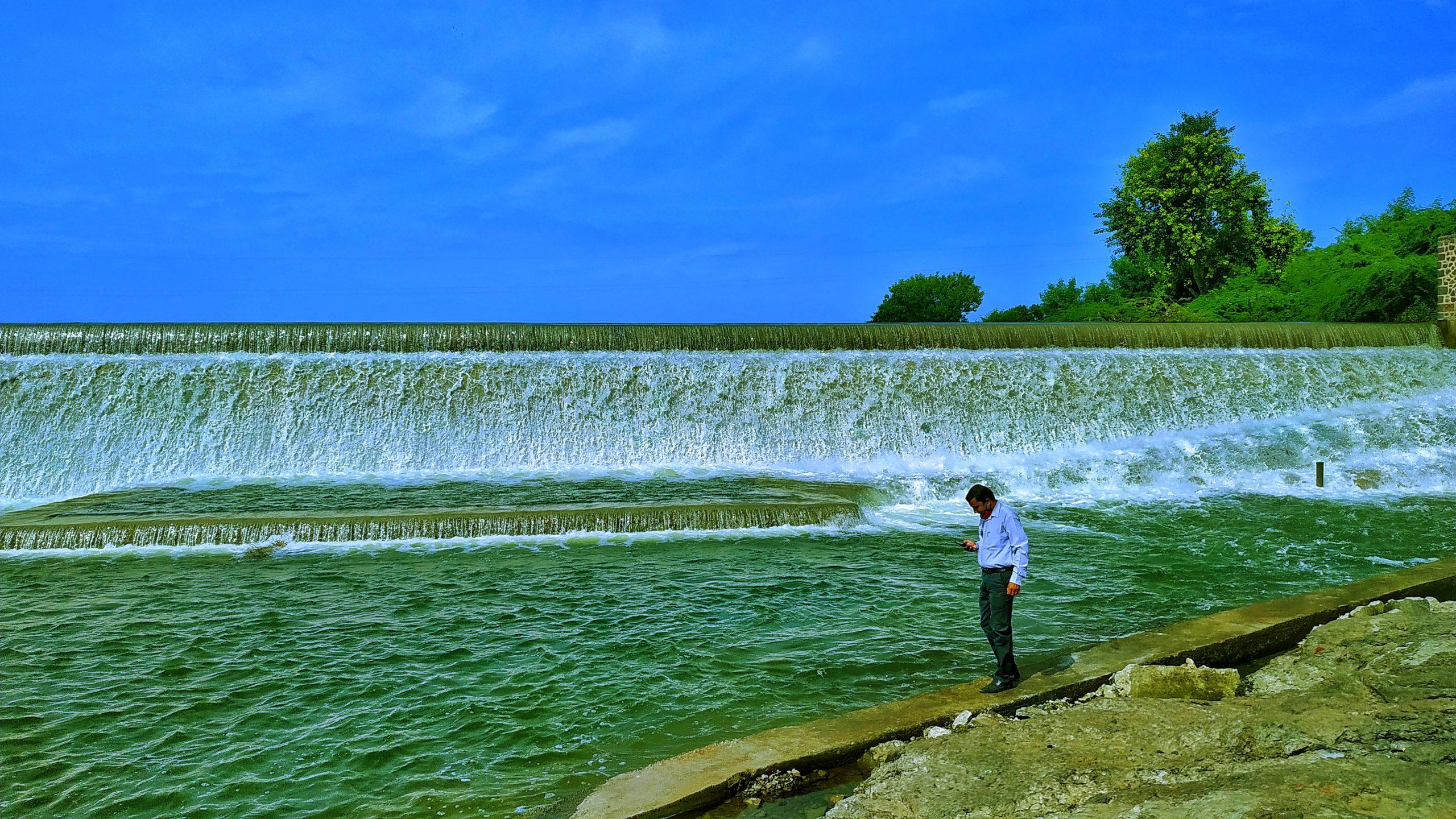 A man beside a waterfall