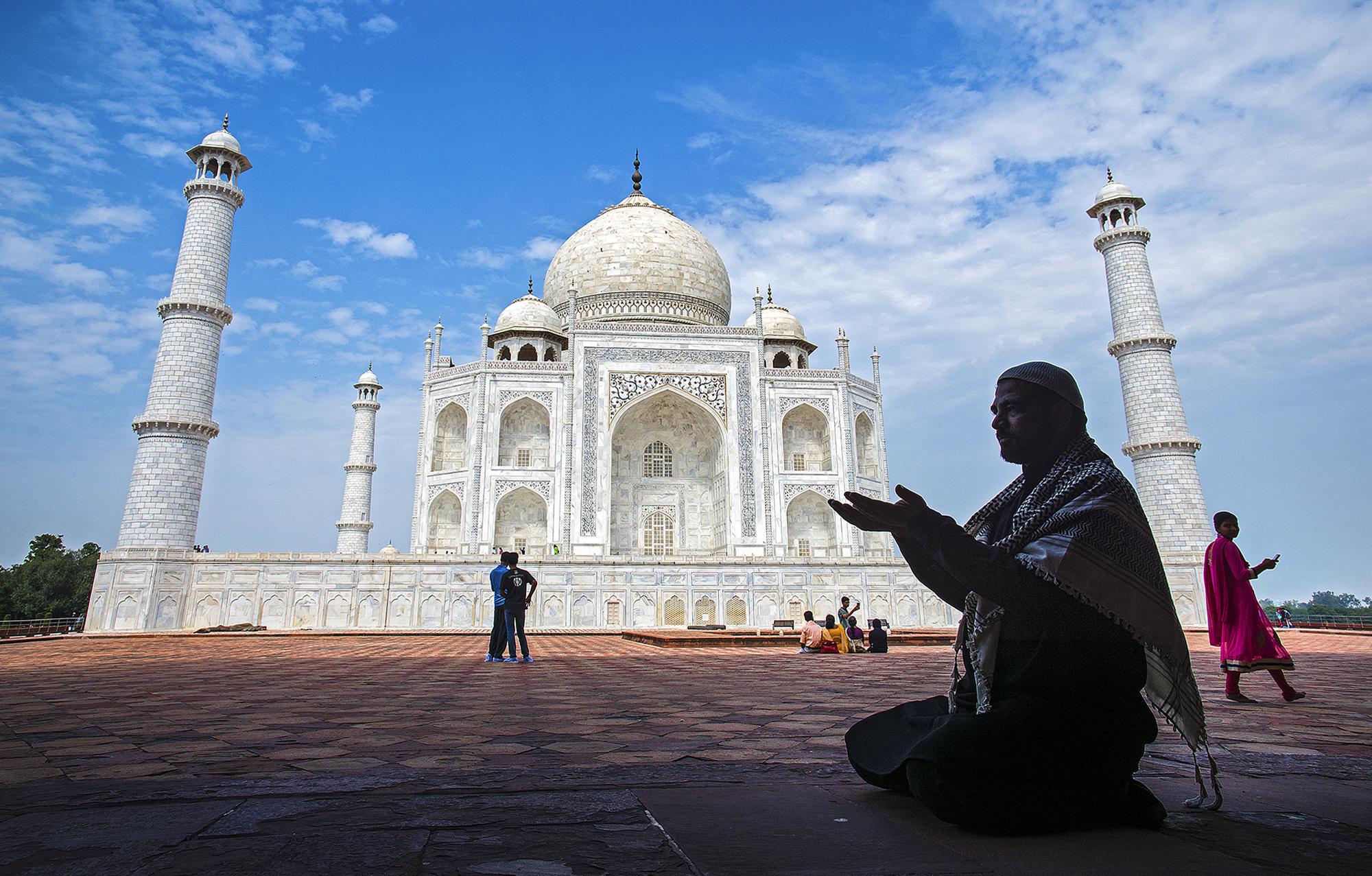 A man offering prayer at Taj Mahal