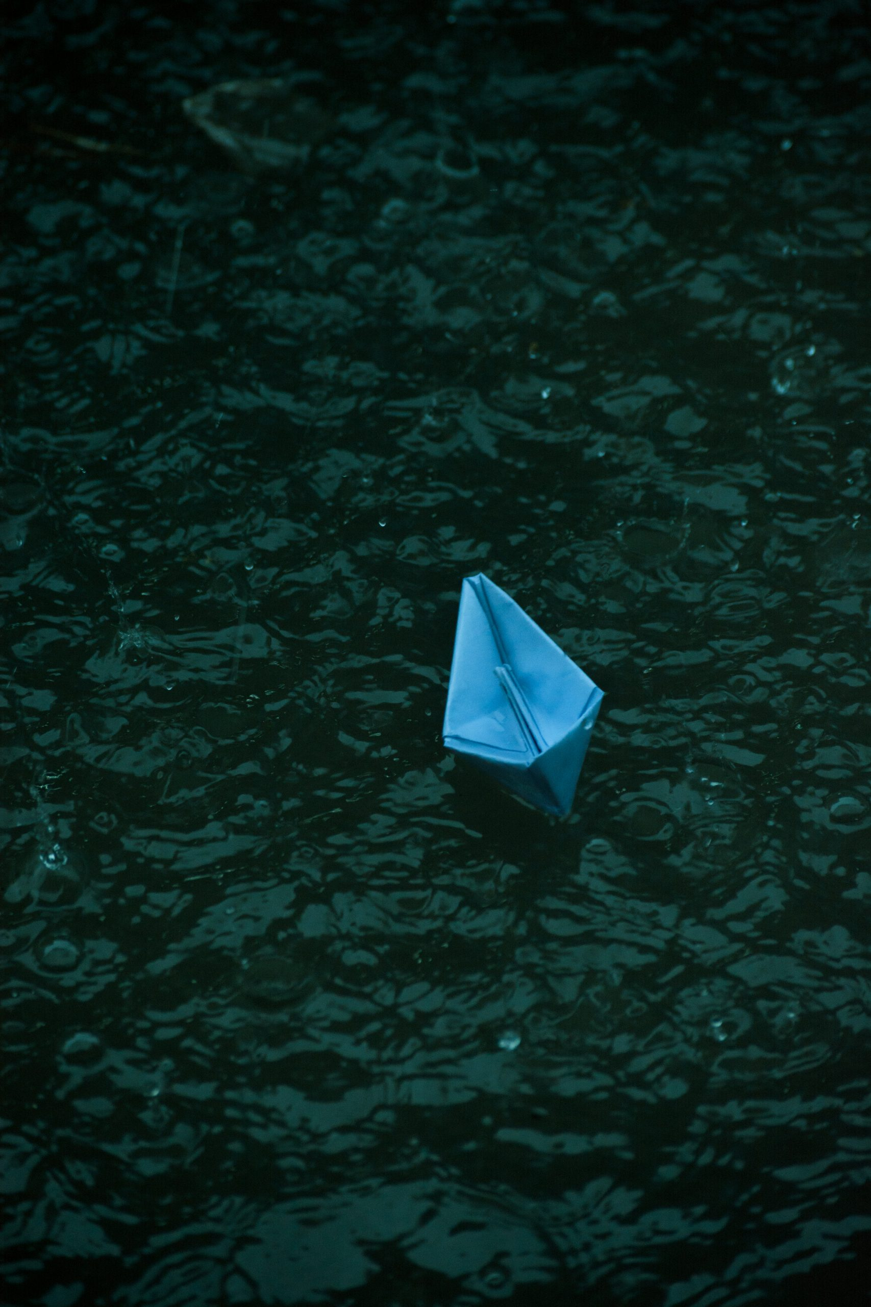 A paper boat in water