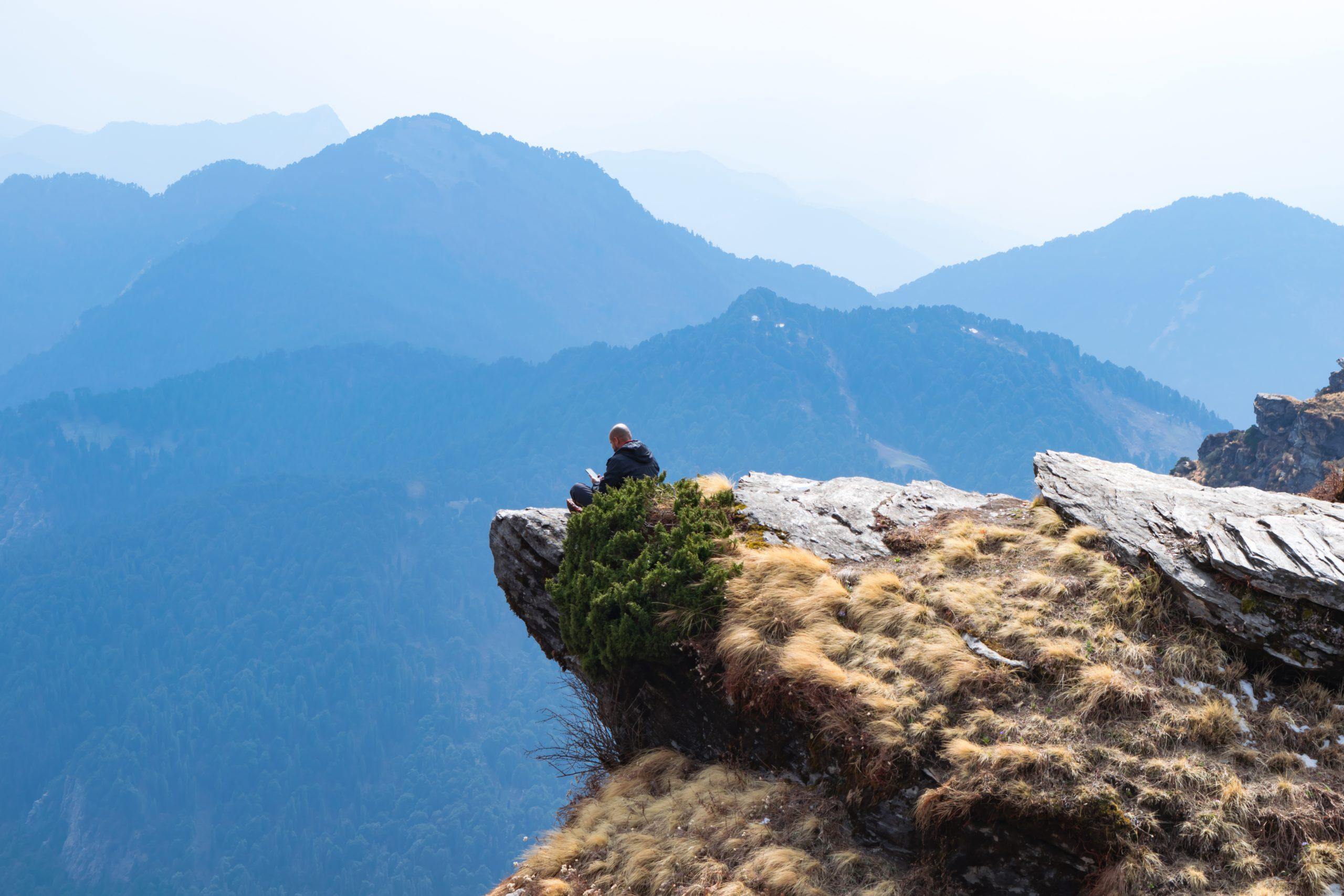 A person sitting on mountain edge