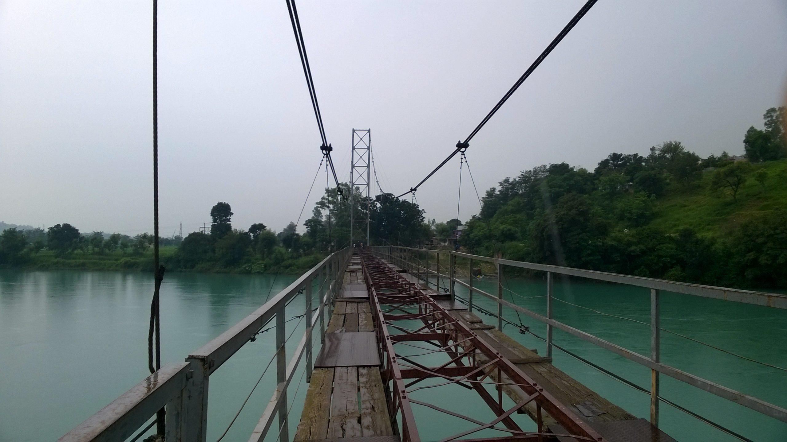 A suspension bridge over a river