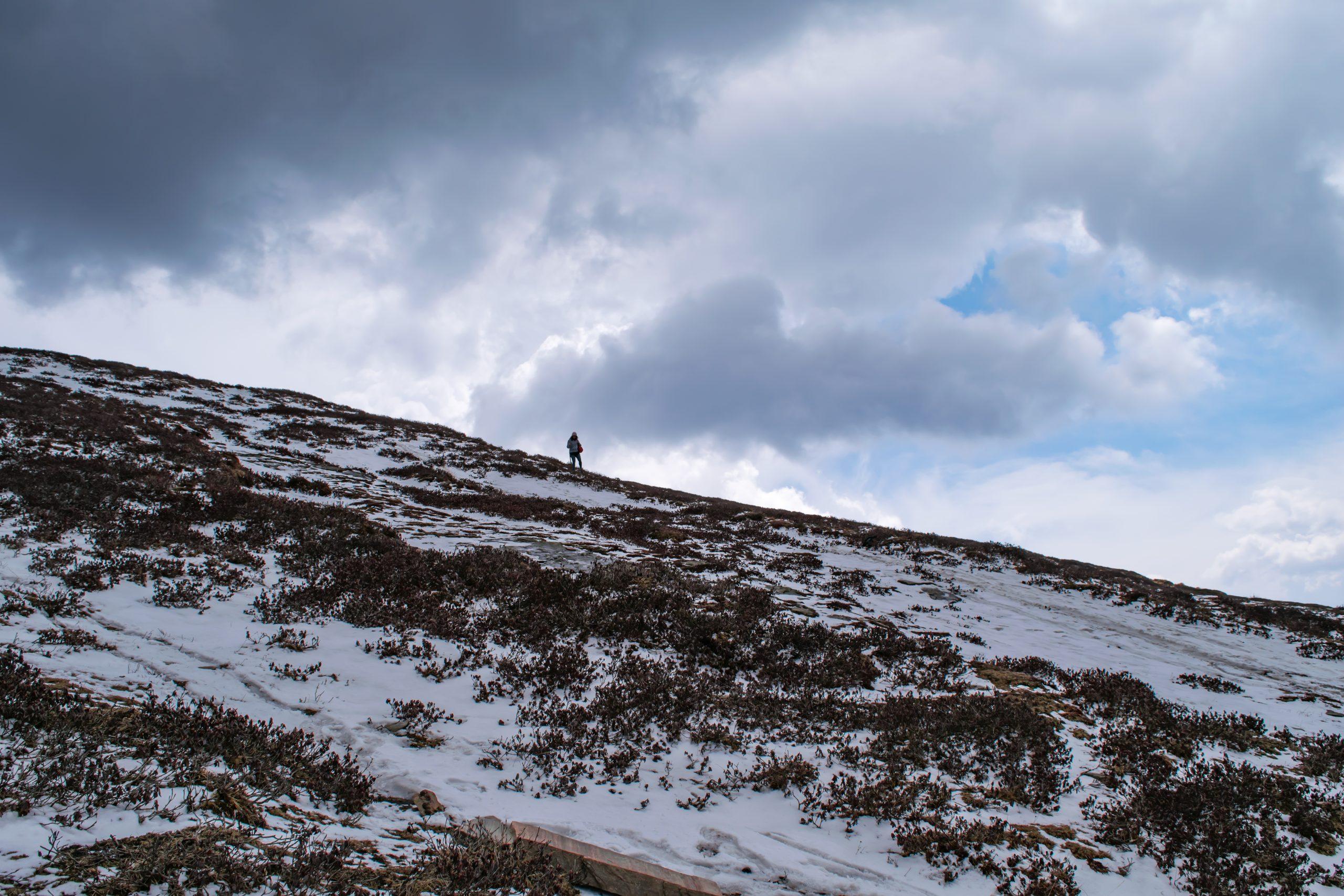 A trekker on a snowy mountain
