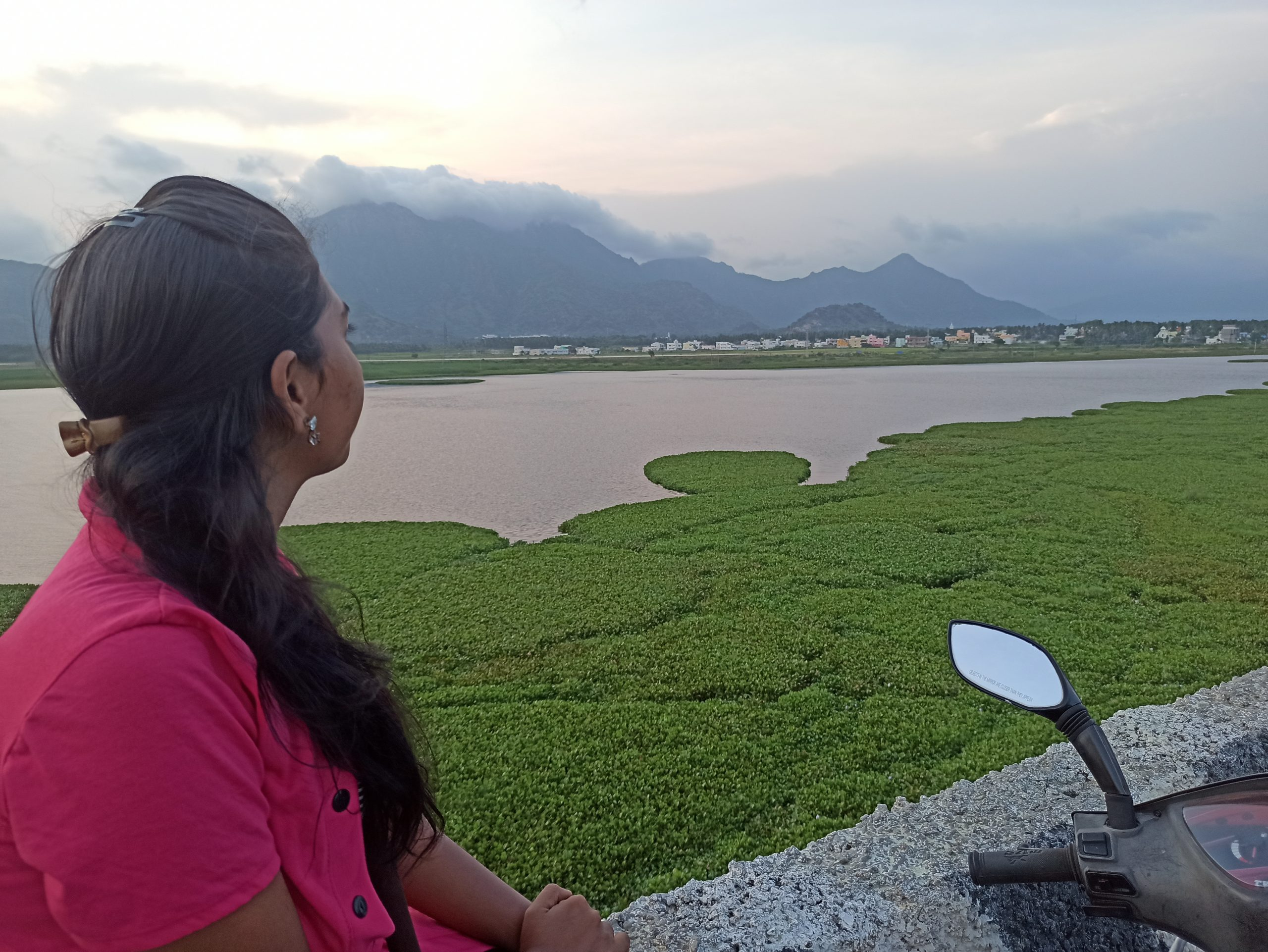 A girl admiring the beauty a Lake