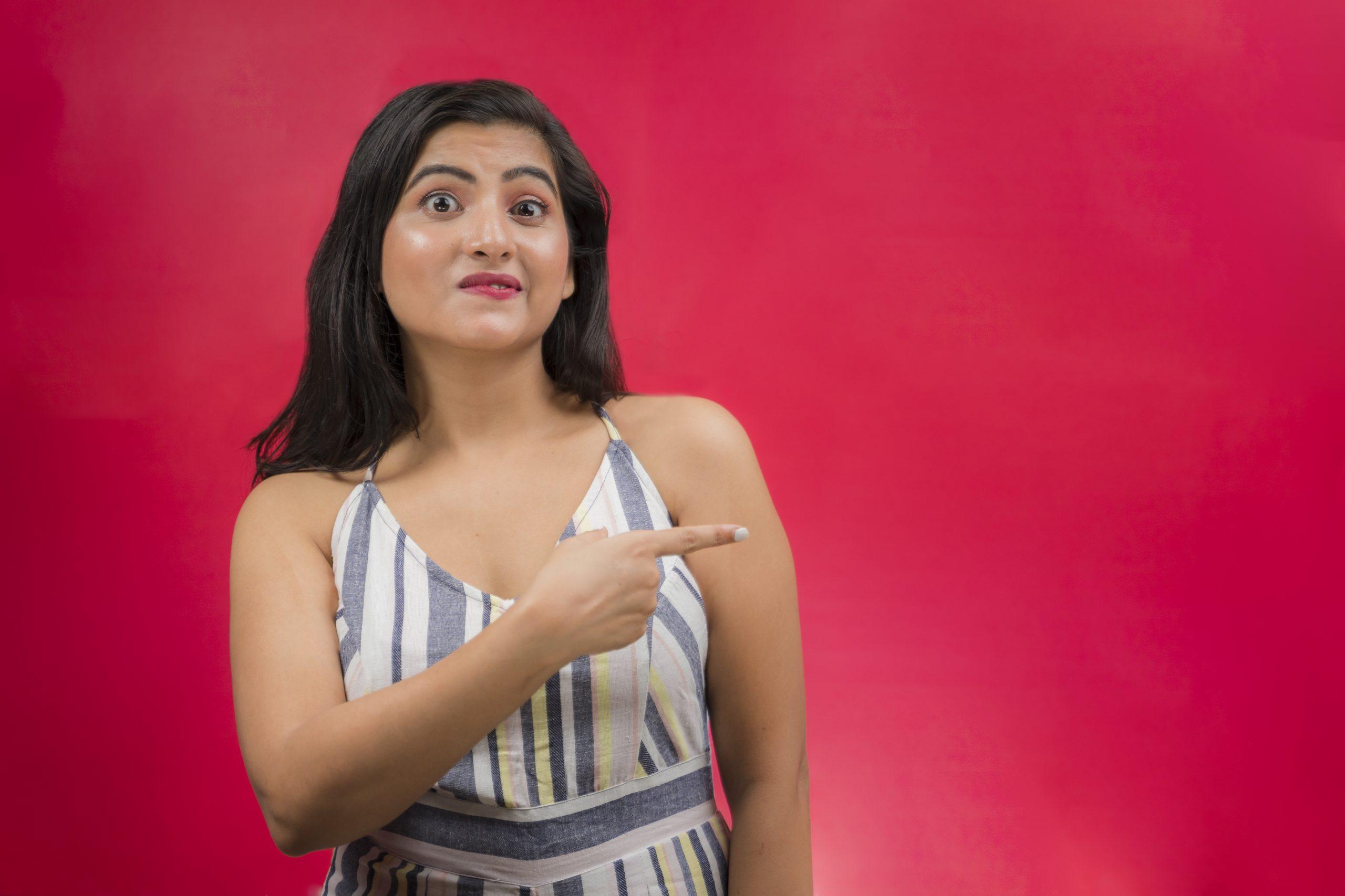 Amazed girl pointing finger
