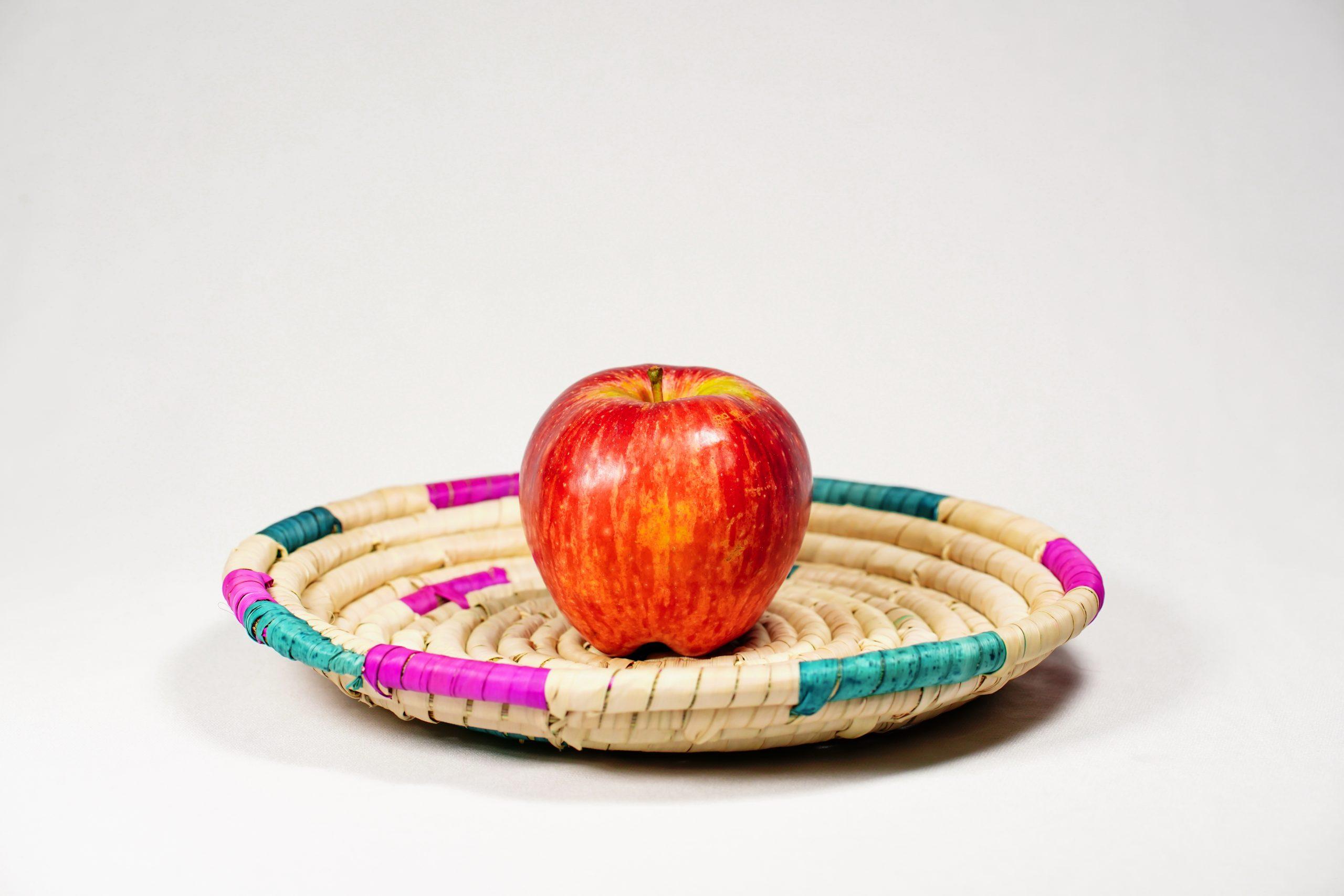 An apple in basket