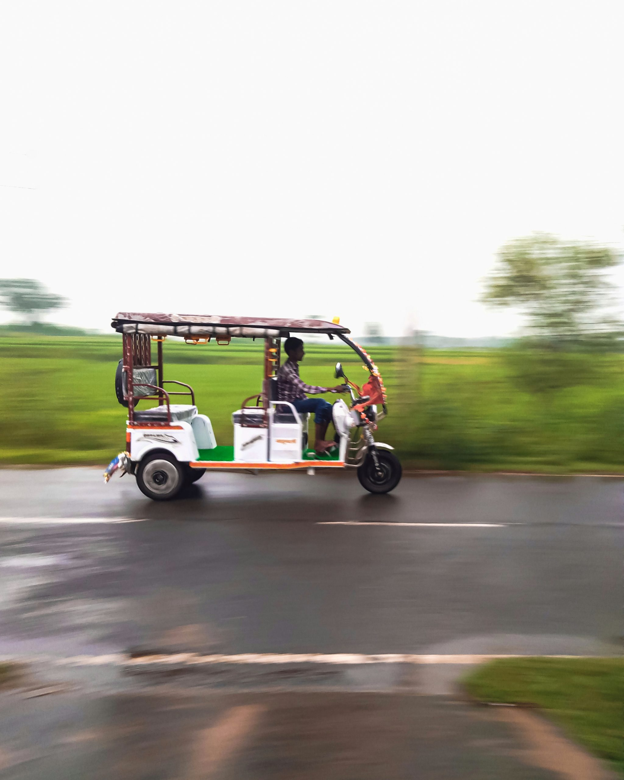 An electric rickshaw in motion