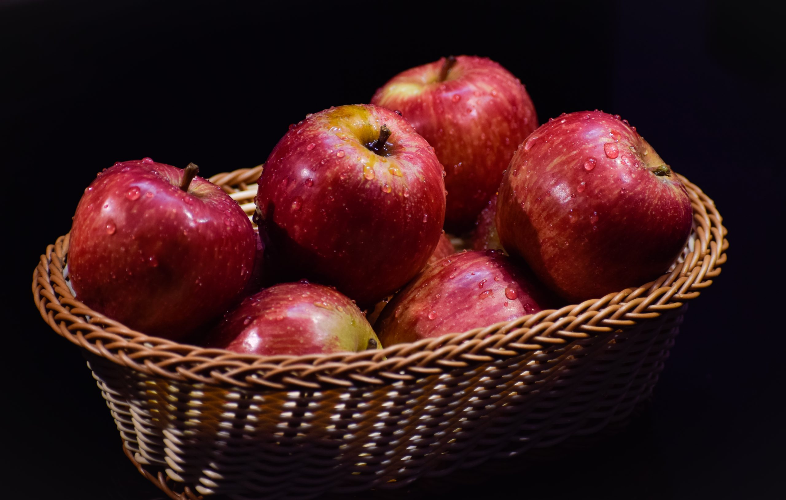 Apple in a Basket on Focus