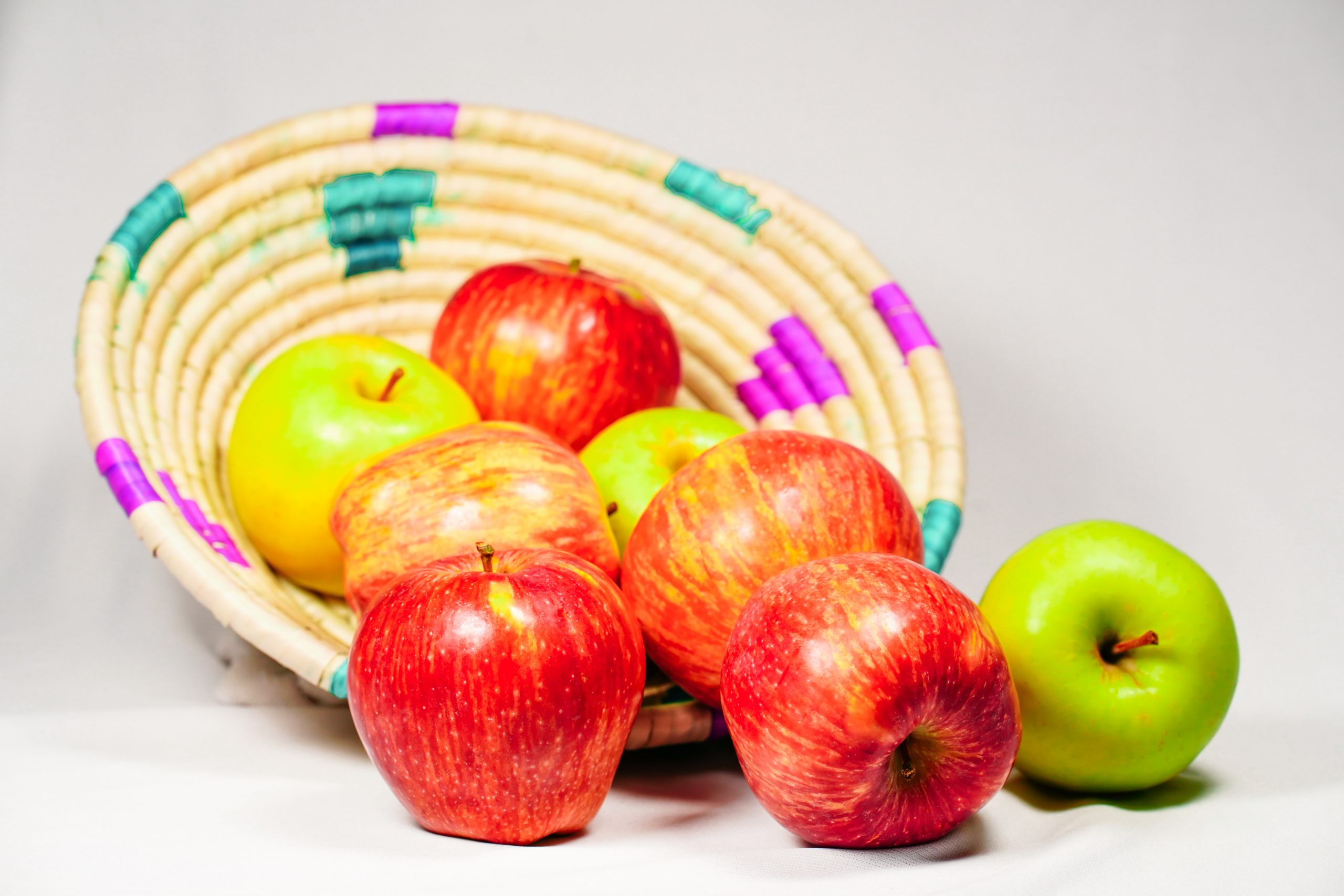 Apples falling from a basket