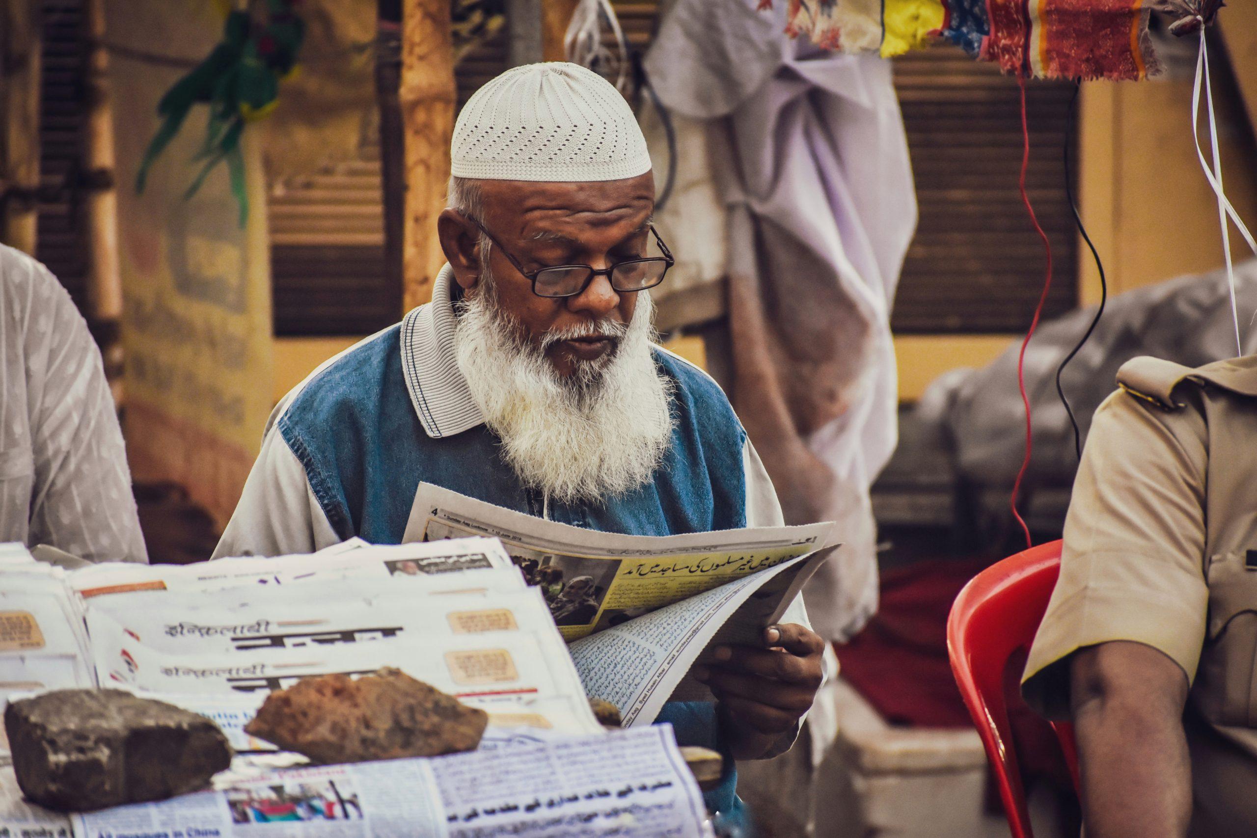 Elderly Reading Newspaper