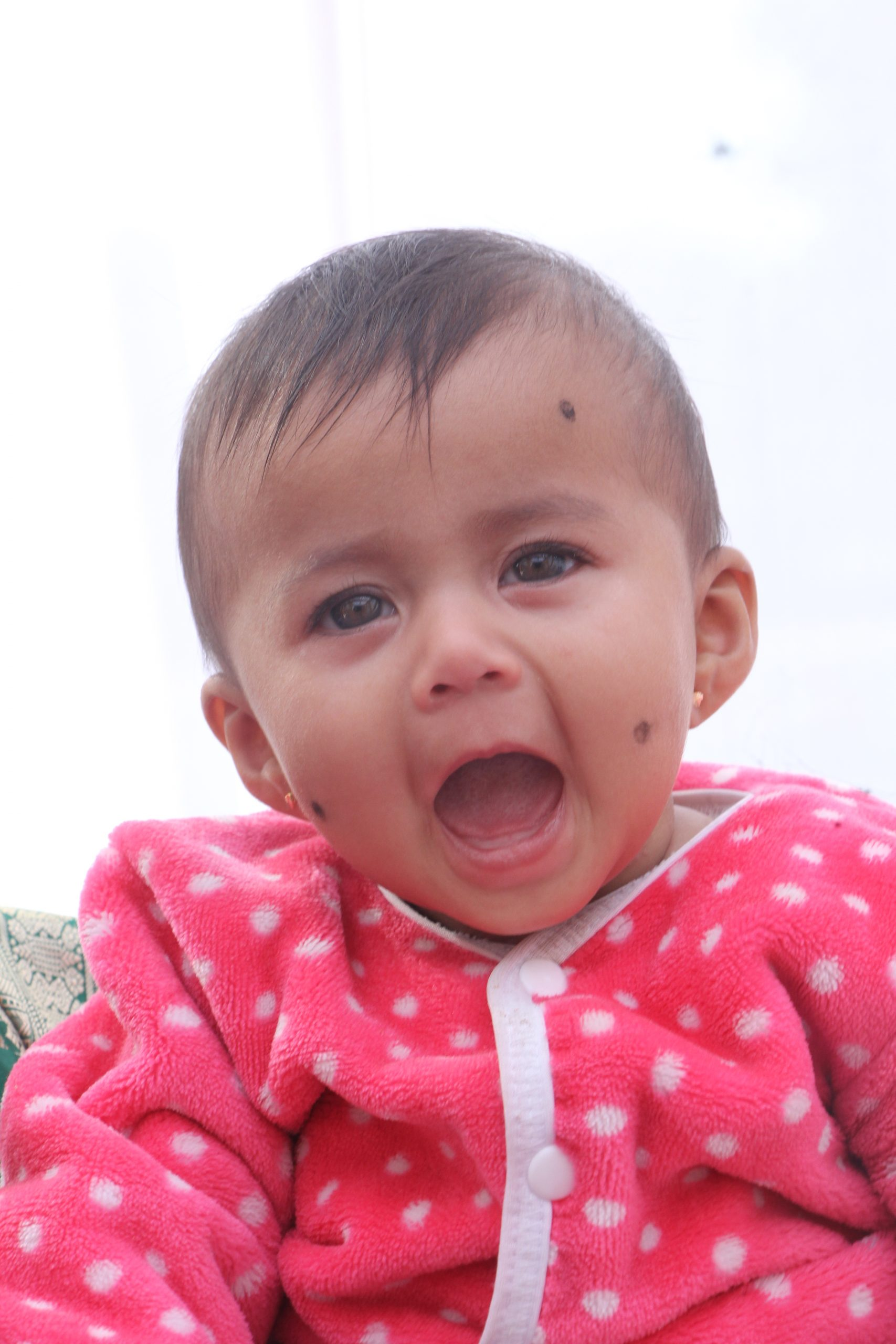 Baby with mouth wide open