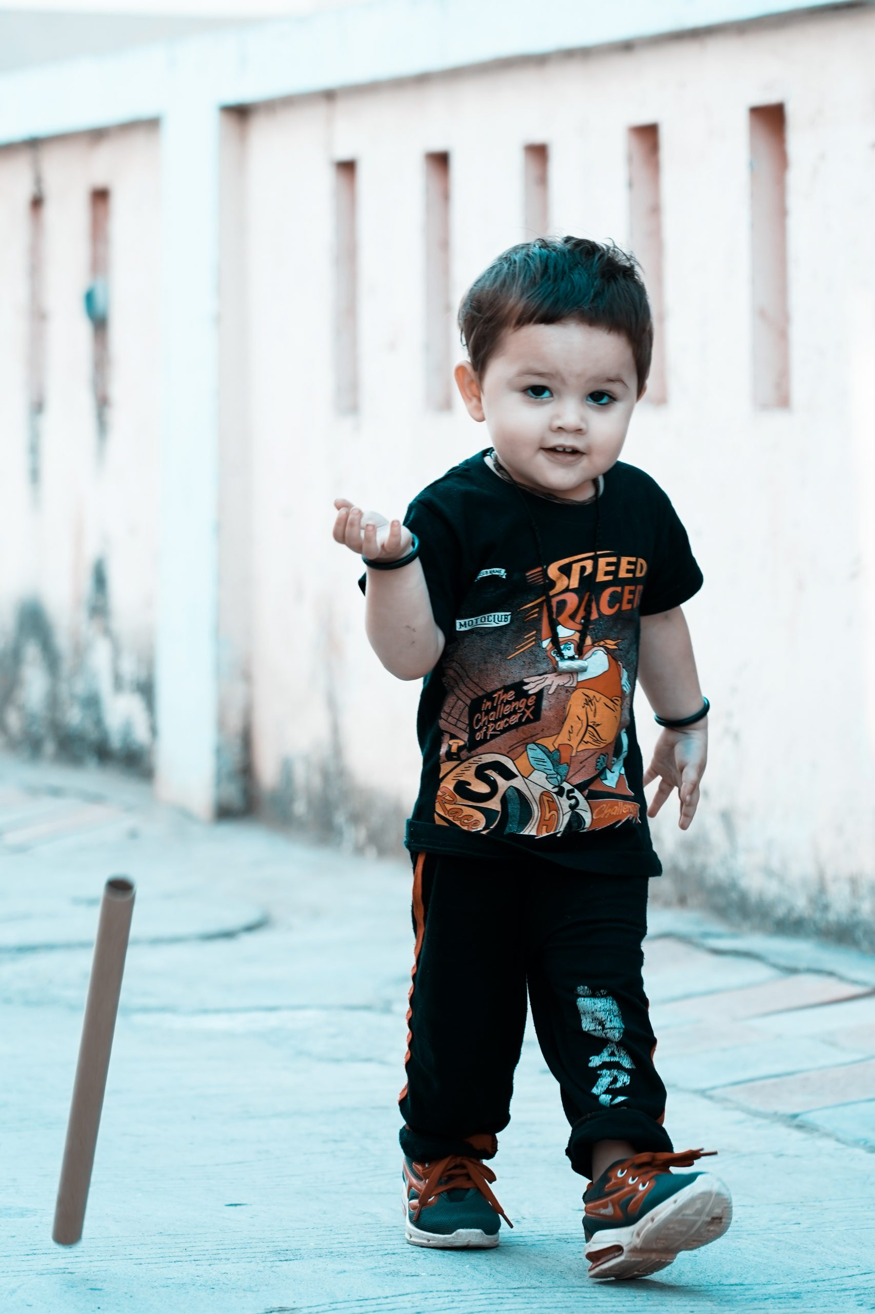 Toddler walking on an alley